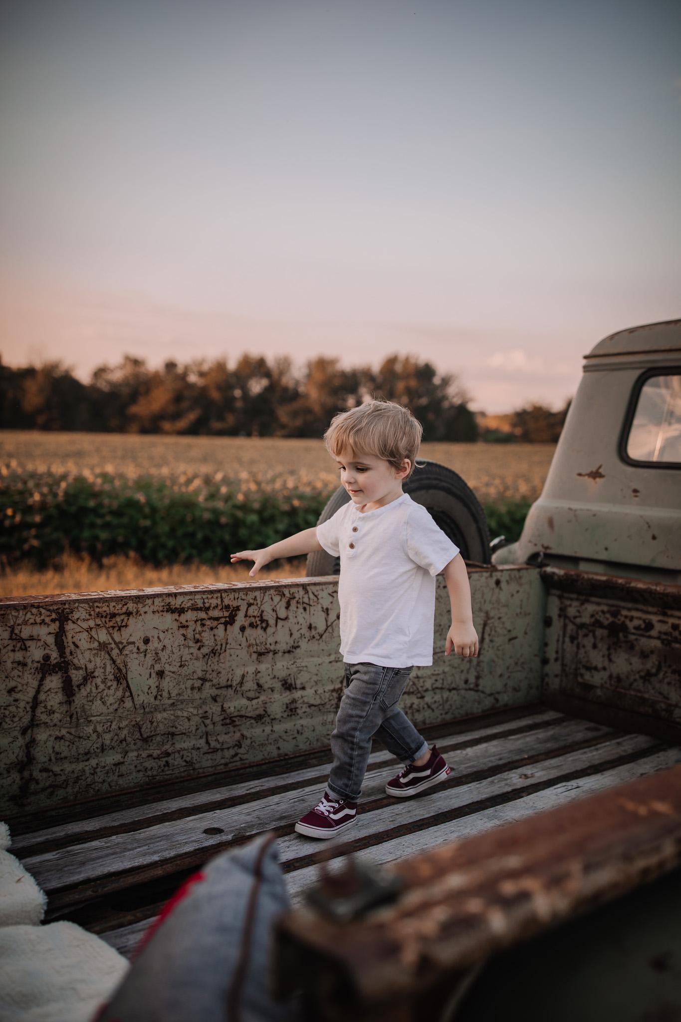 little toddler in vintage truck bed