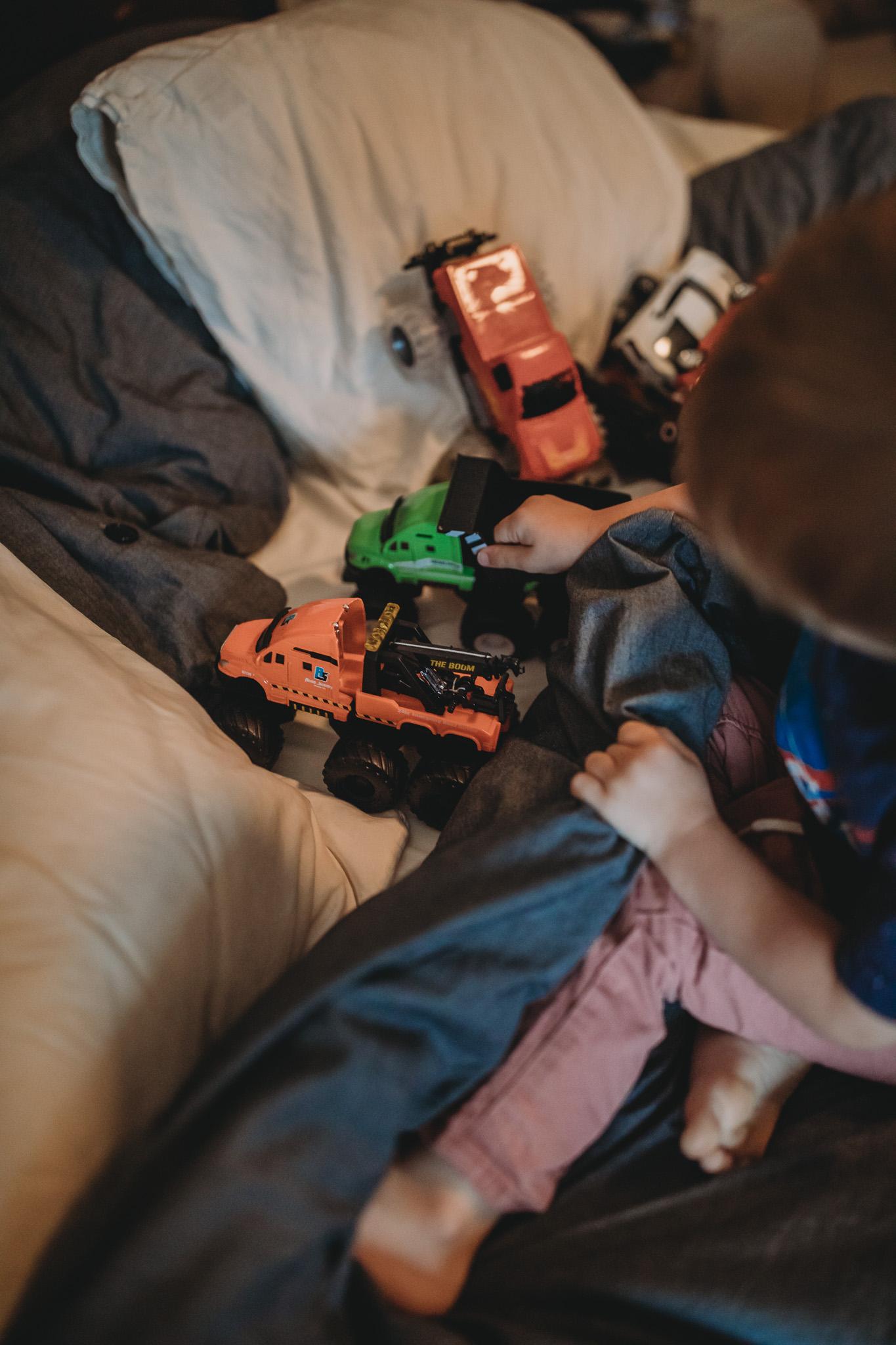 boy with toy trucks