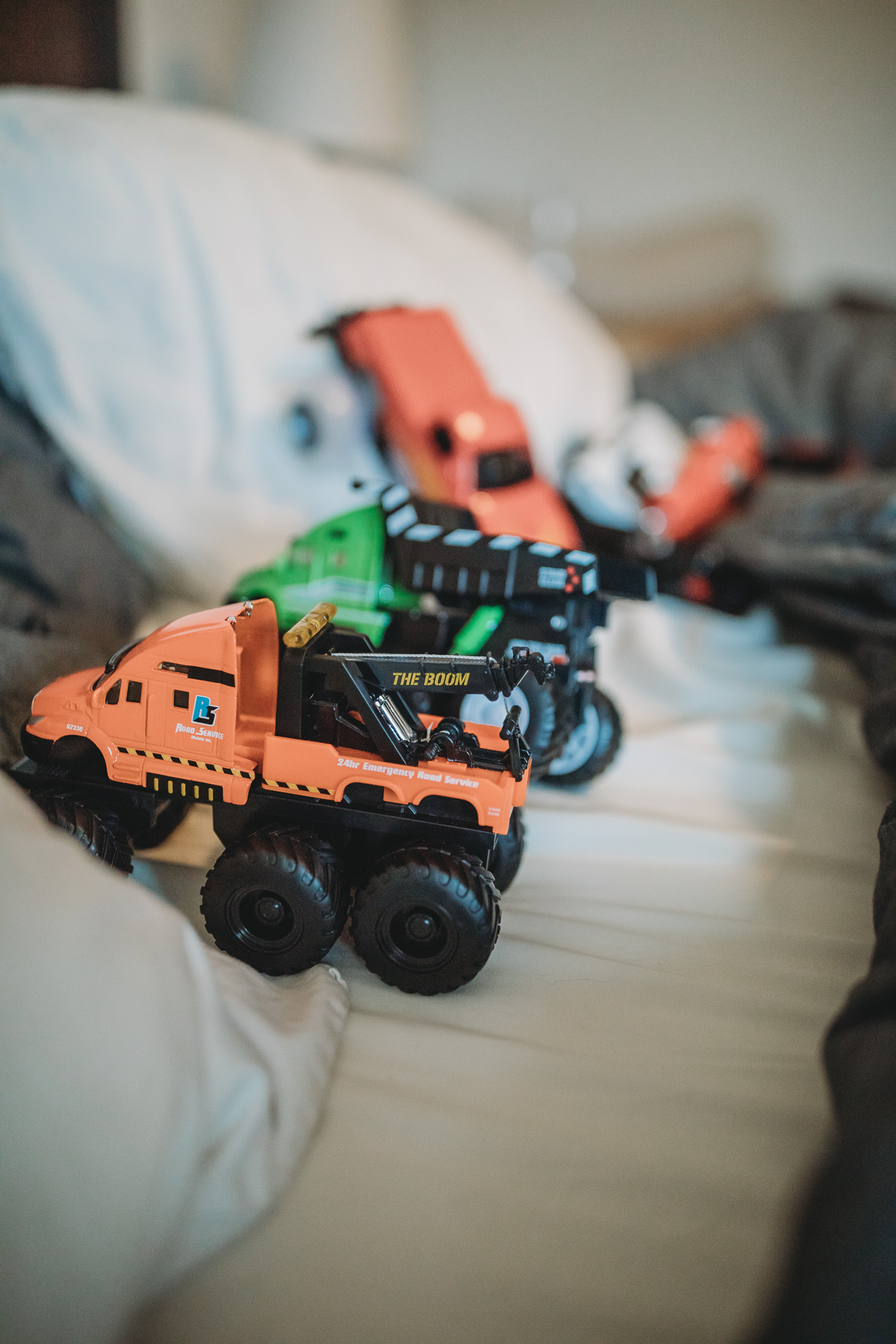 toy trucks in a bed