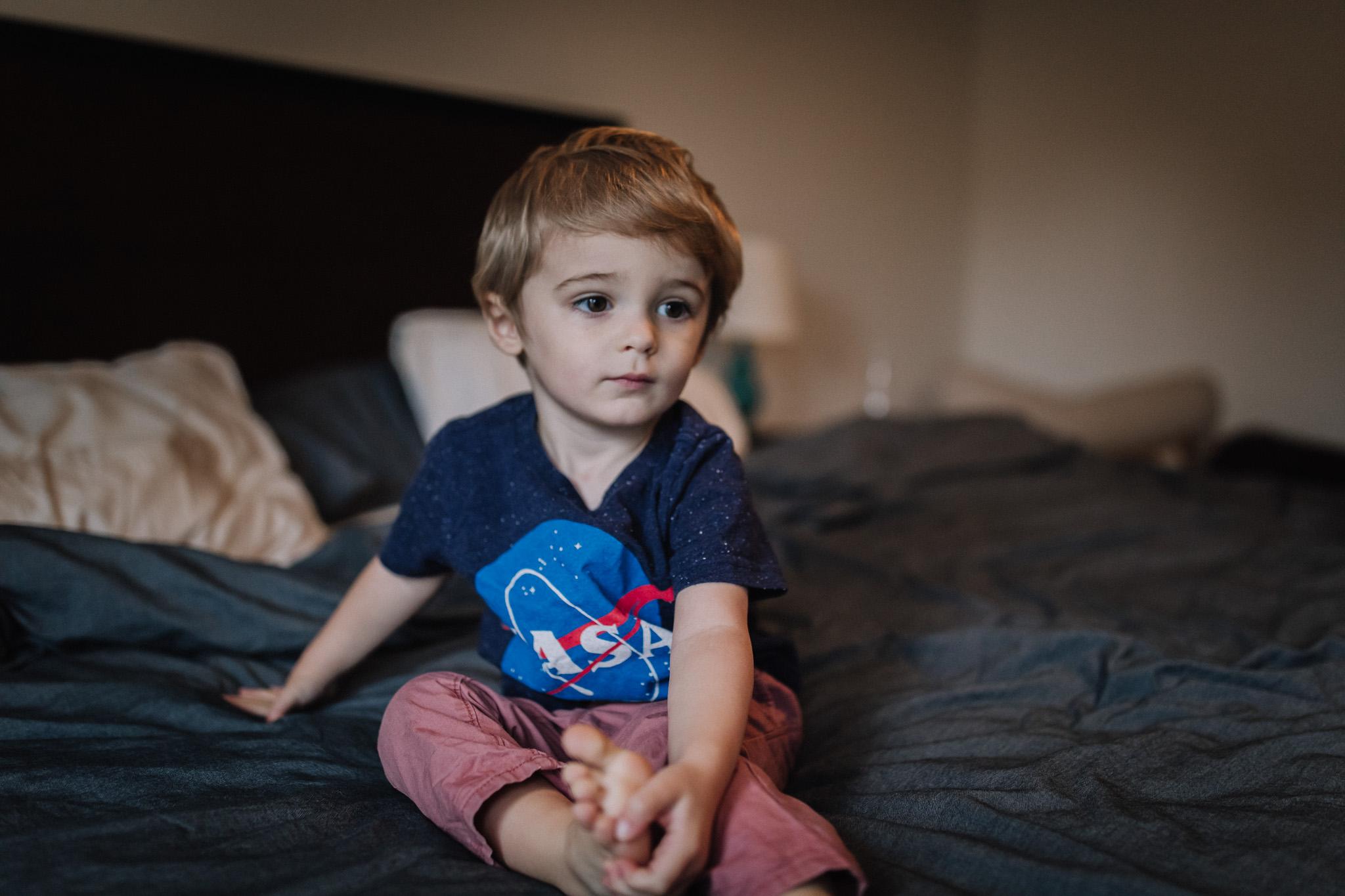 little boy on bed
