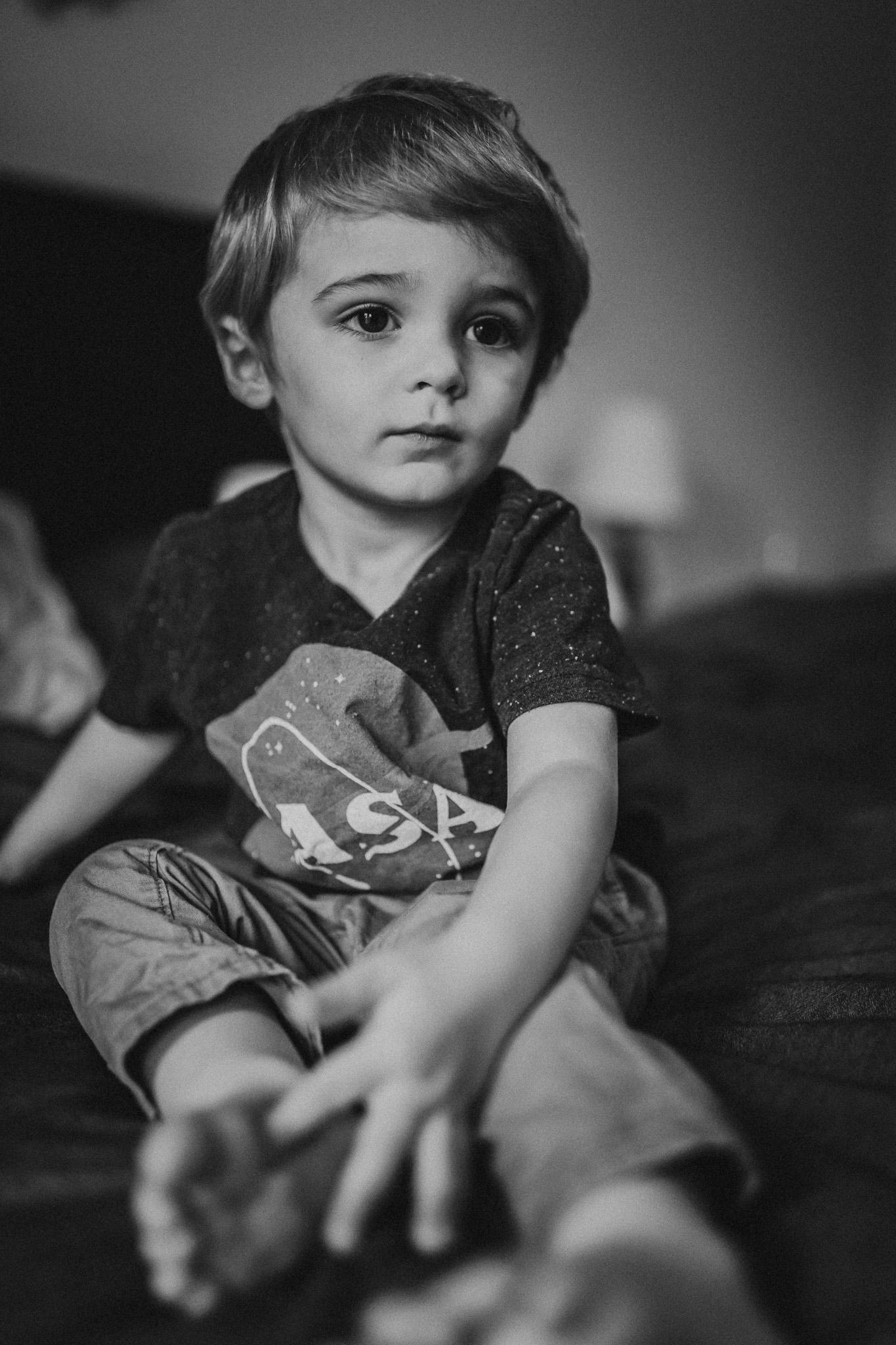 little boy sitting in bed