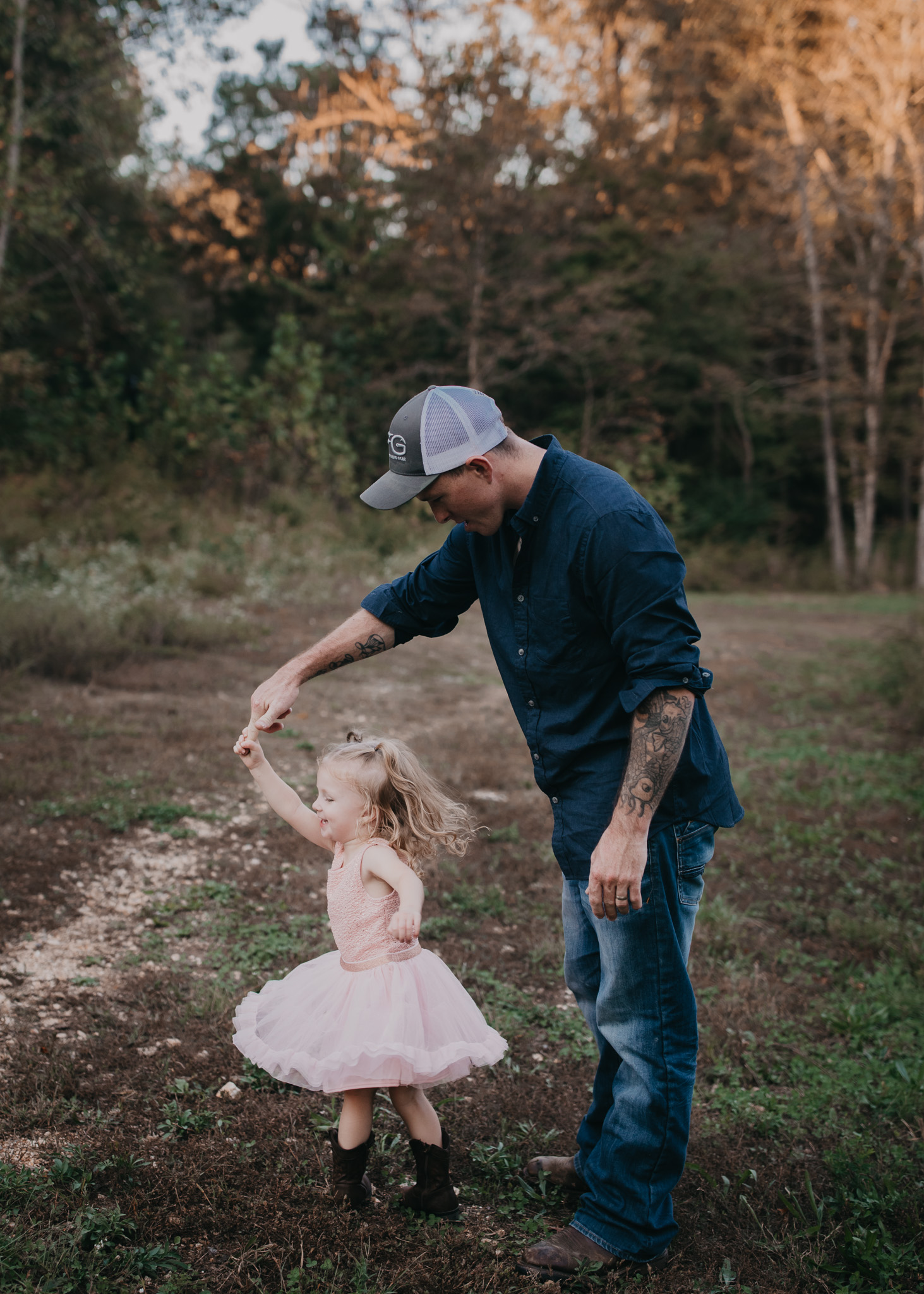 dad twirling daughter
