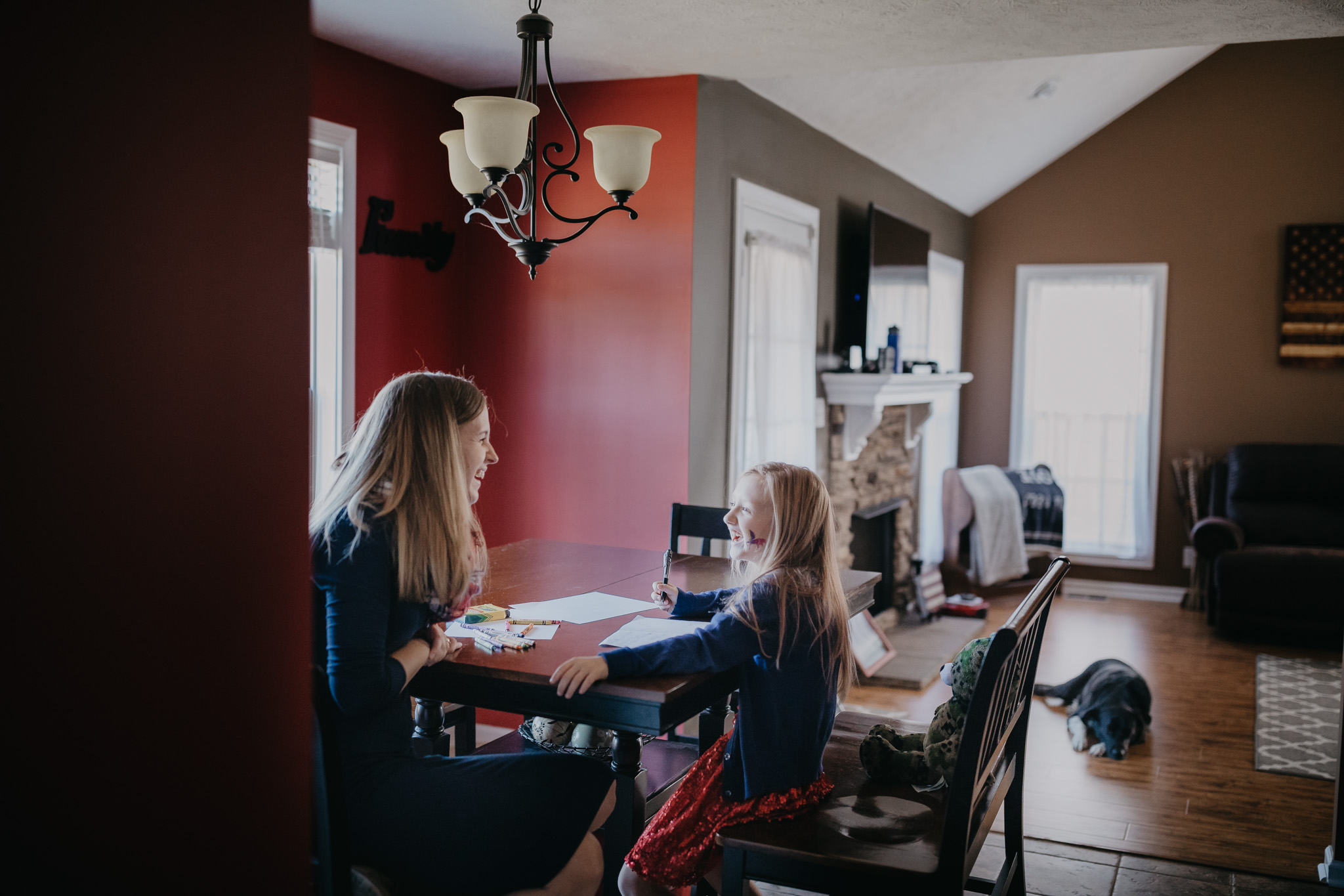 mom and daughter writing to dad
