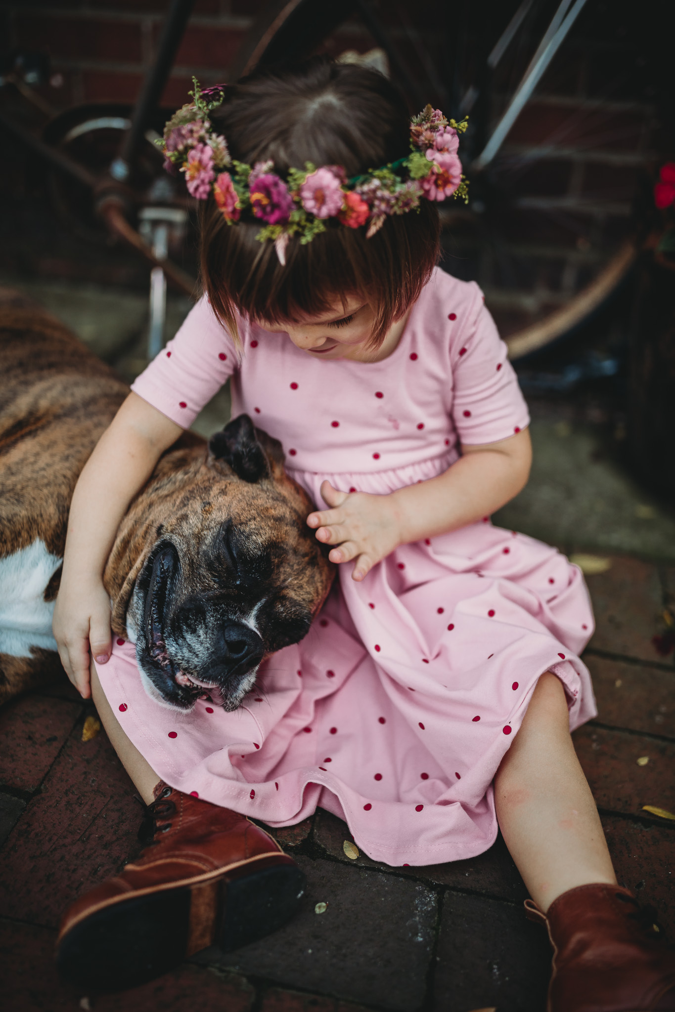 little girl petting her dog