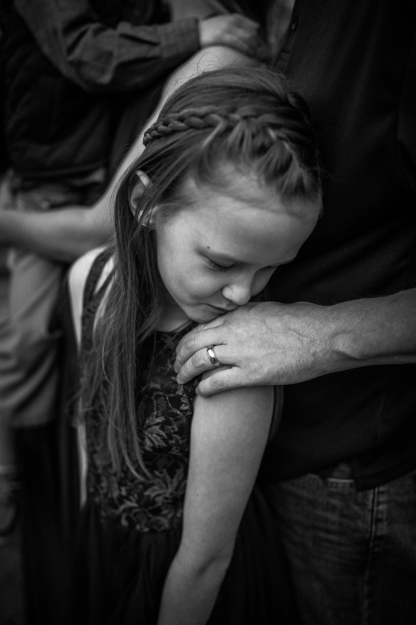 little girl kissing dad's hands