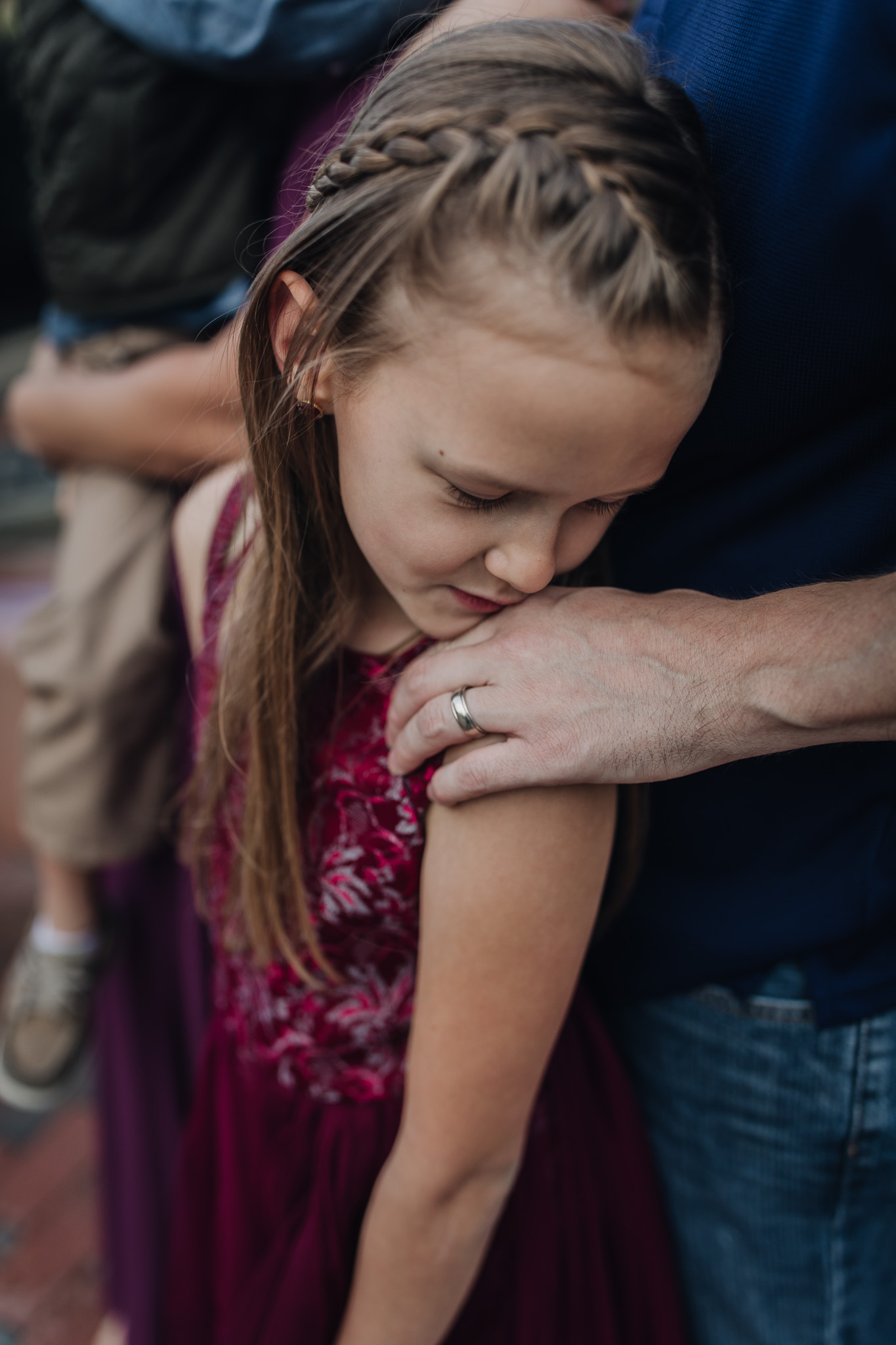 daughter kissing dads hands