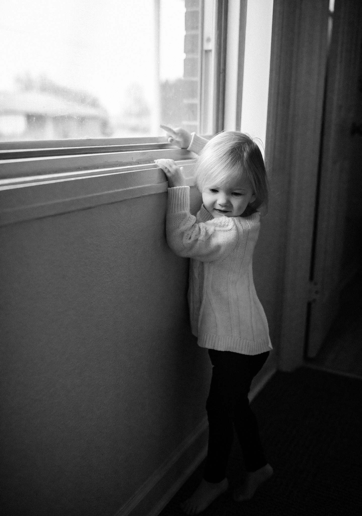 toddler at window