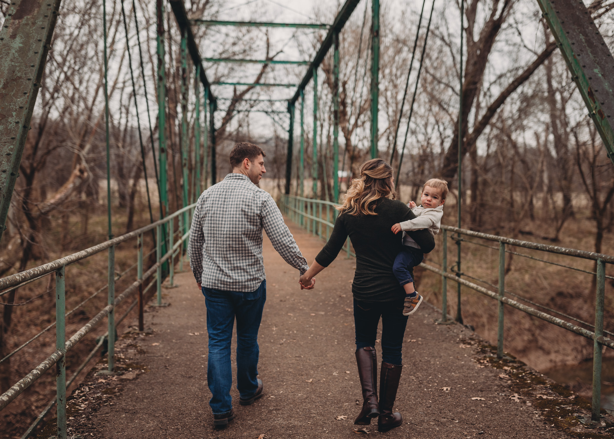 walking together on bridge family session