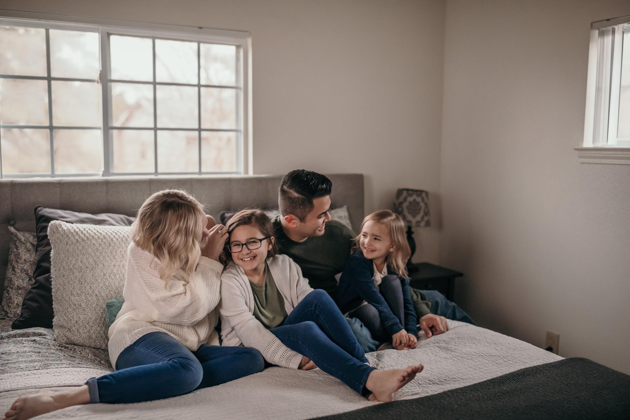 family of four pose