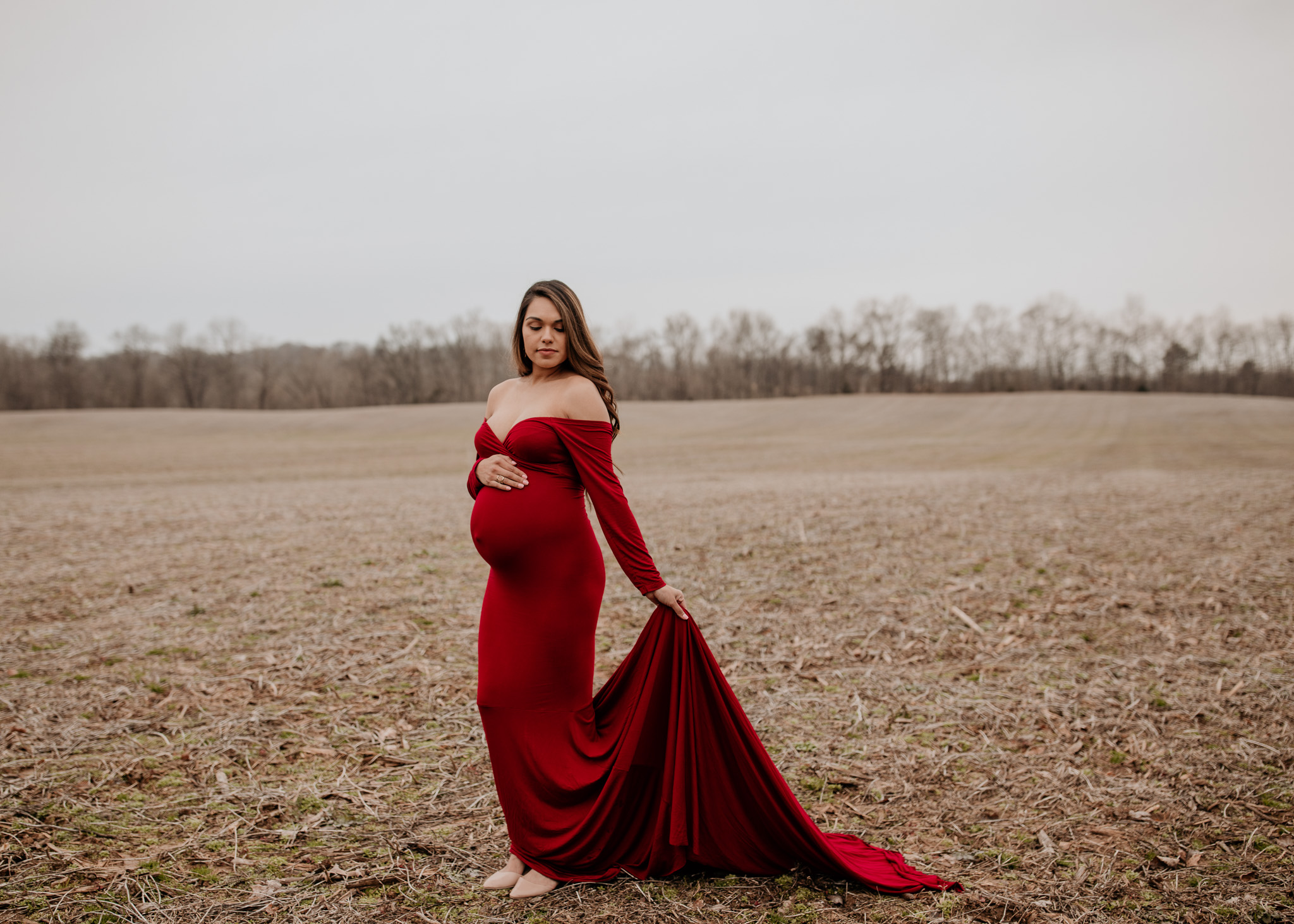 maternity gown red outdoor winter pose