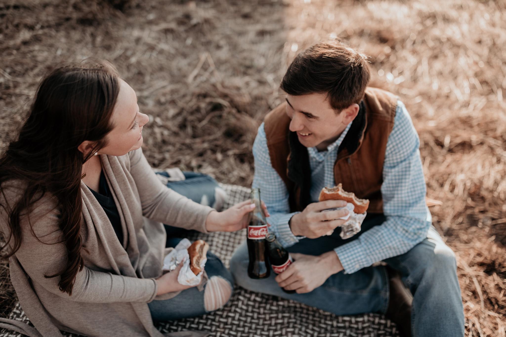 couple enjoying burger engagement session