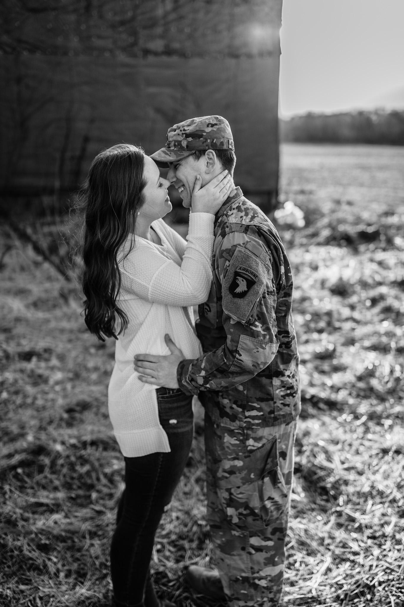 army man in uniform kissing girl