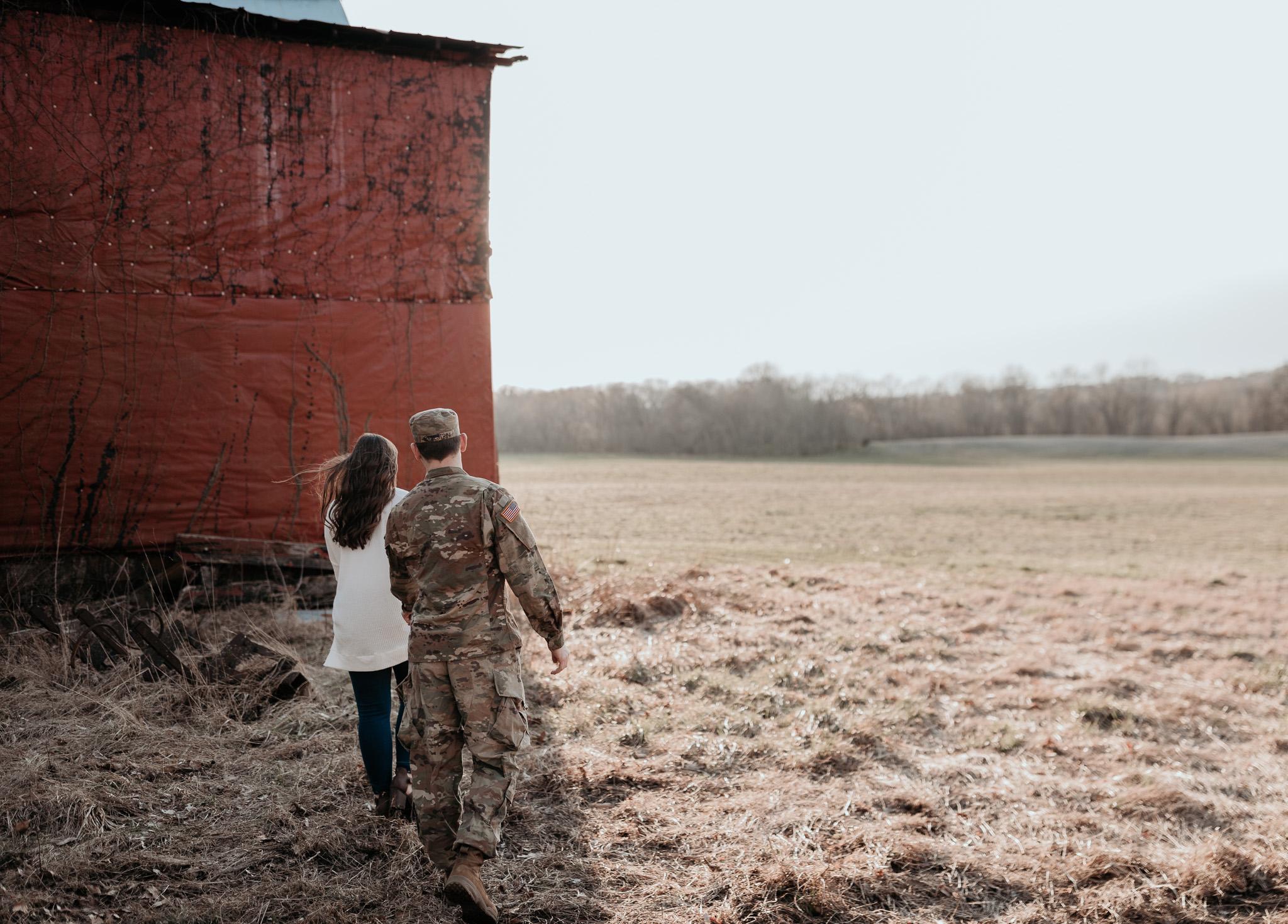 woman leading man in army uniform