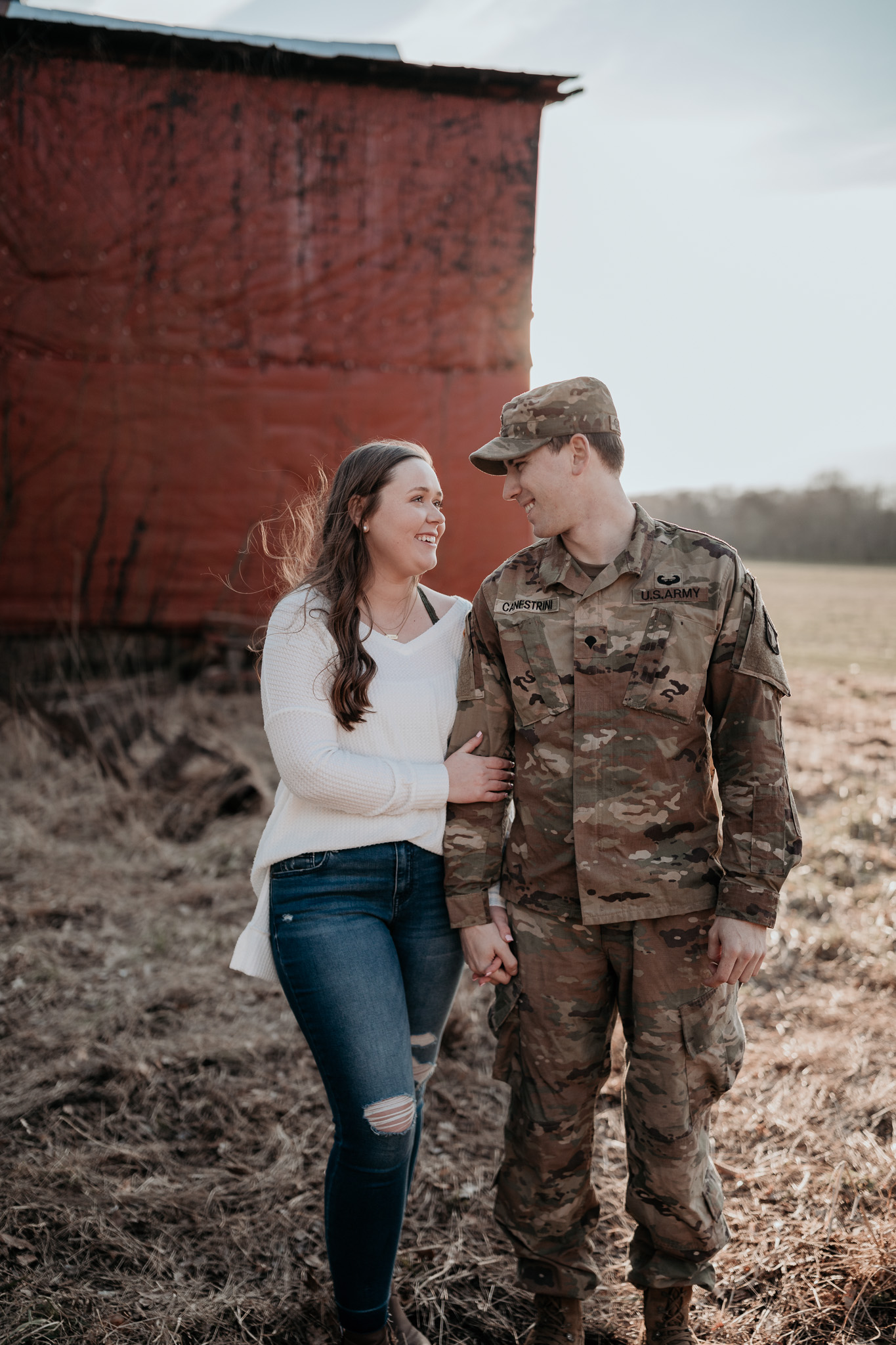 man in army uniform with girl