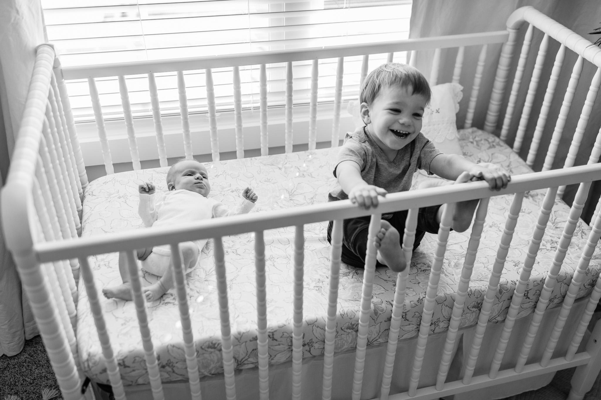 Black and White Siblings in Crib
