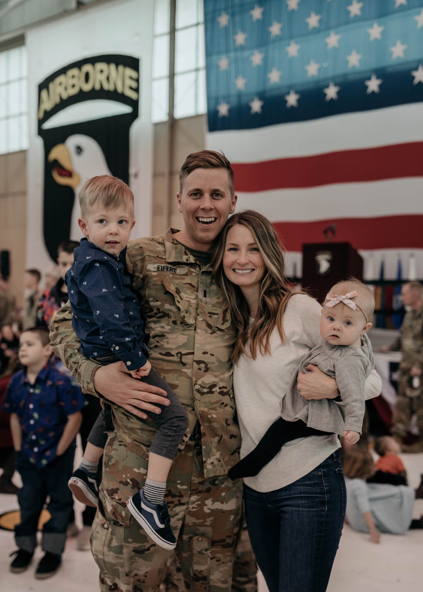 Soldier Stands with Family Upon Returing Home