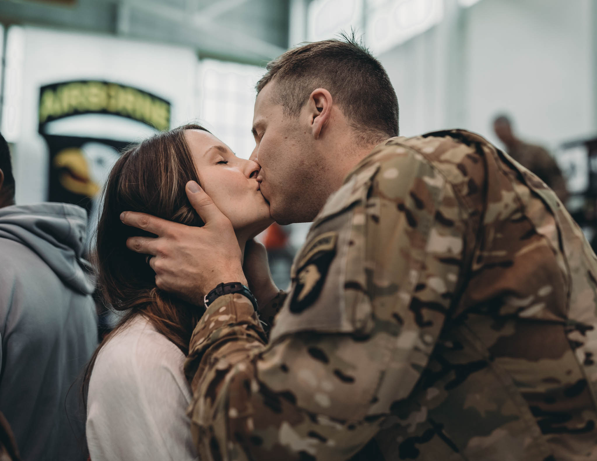 Soldier and Wife Kissing