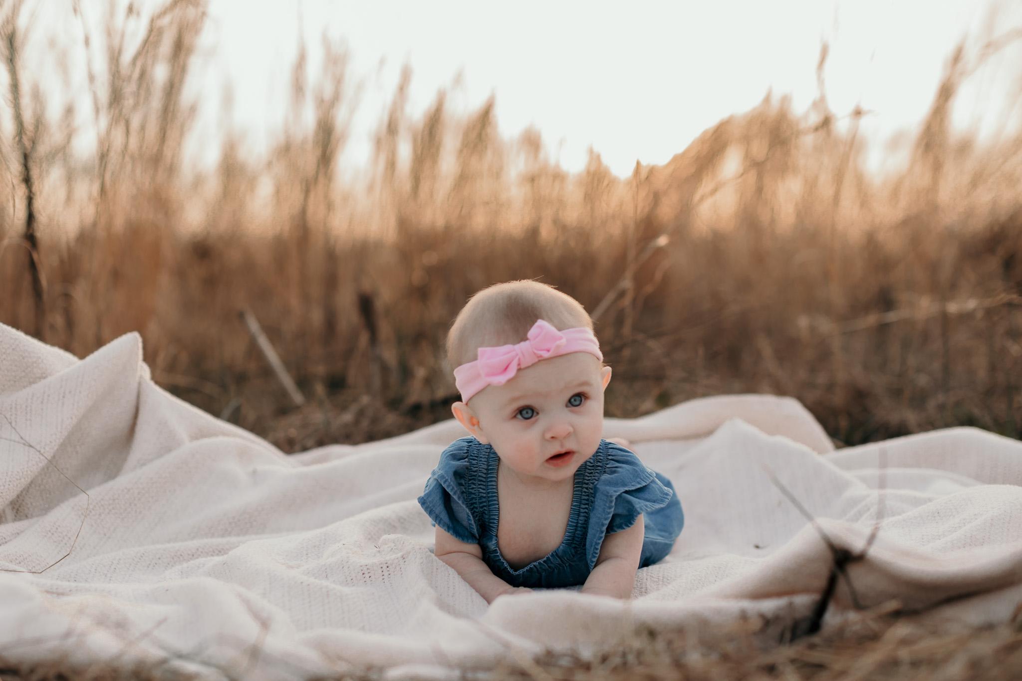 Baby Girl Playing on Blanket