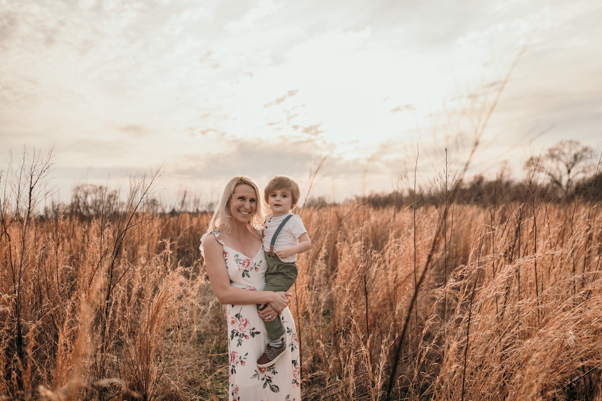 Mother and Son Standing in Field