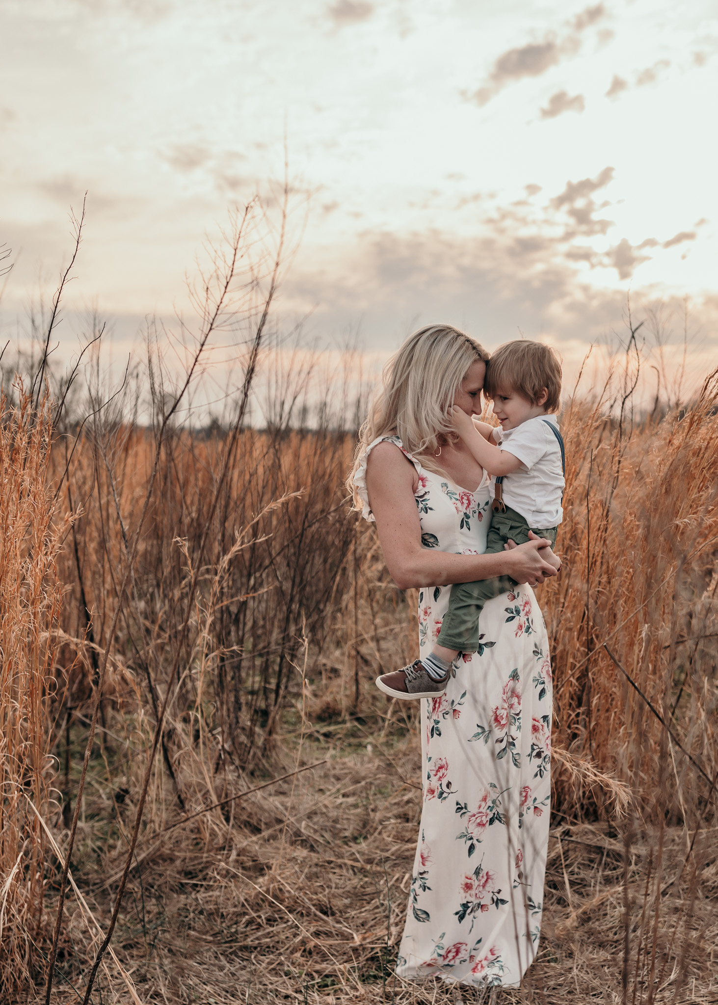 Mother Embracing Son in Field
