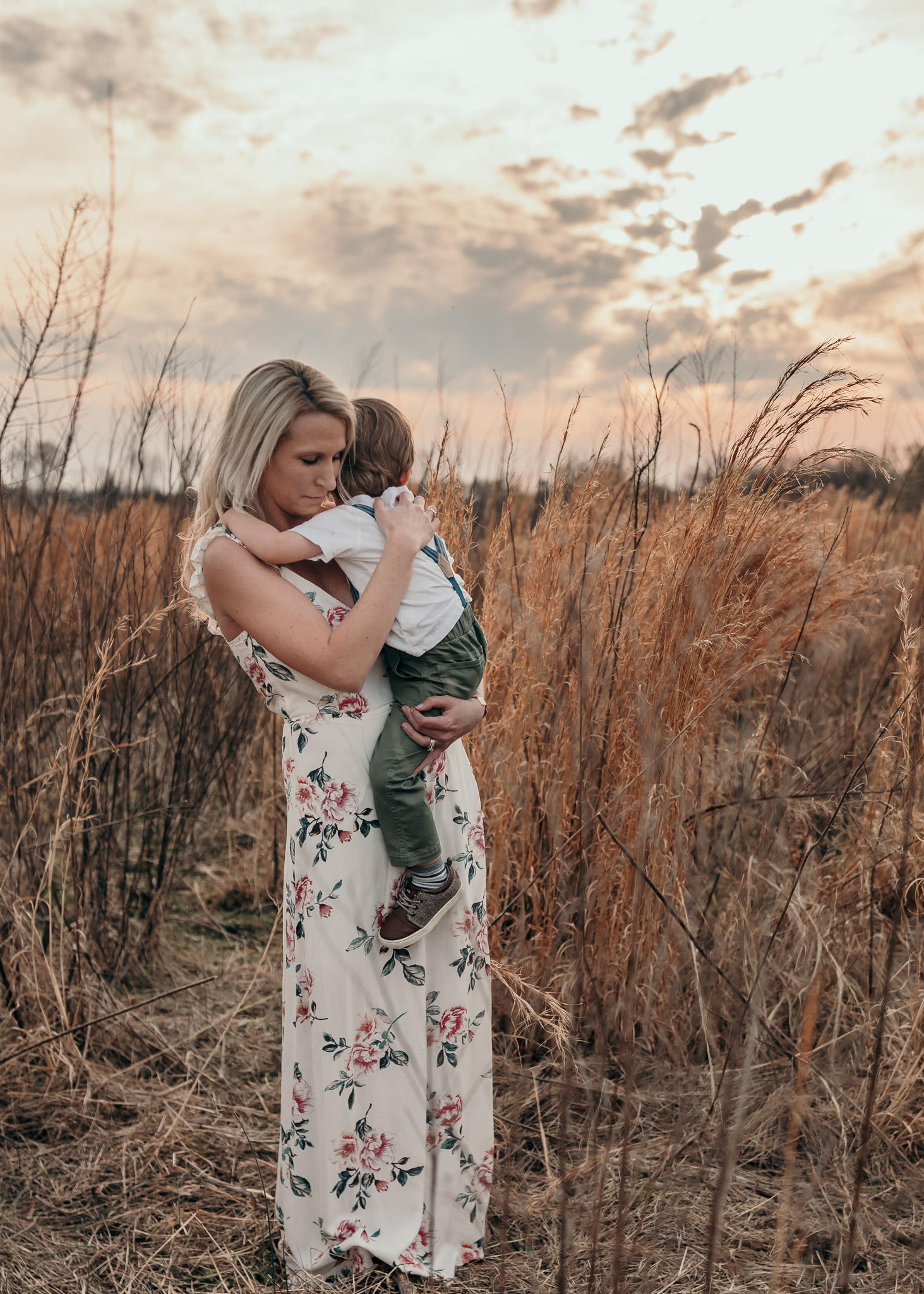 Mother Holding Son in Field