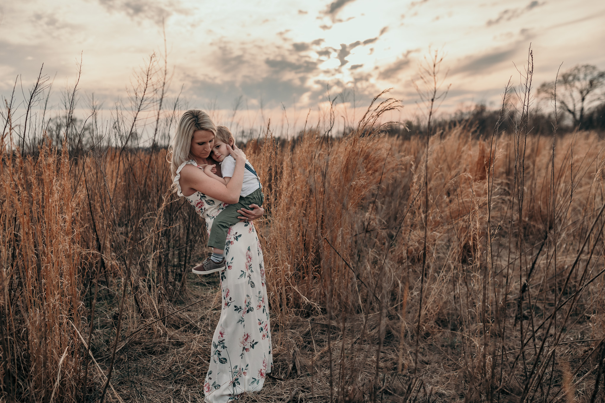 Mother Embracing Child in Field