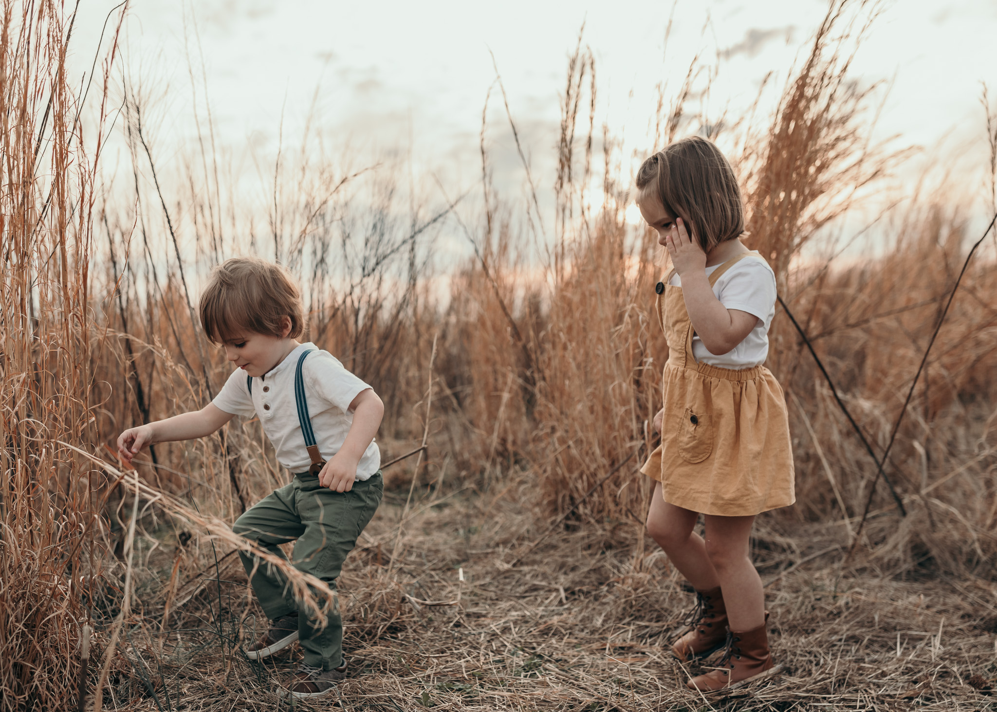 Toddlers Playing in a Field