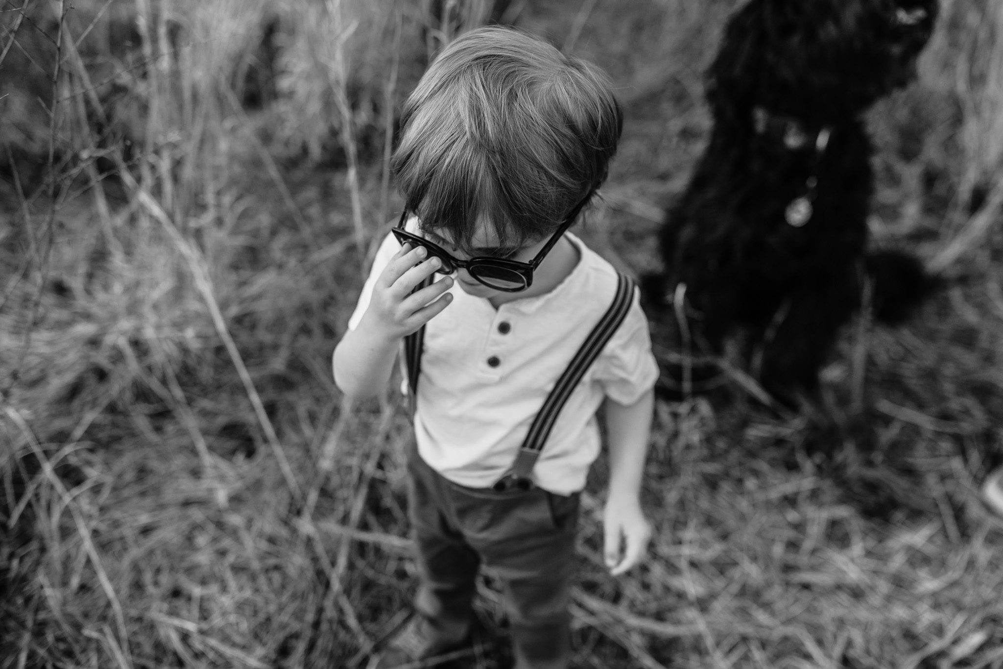 Black and White Young Boy in Field