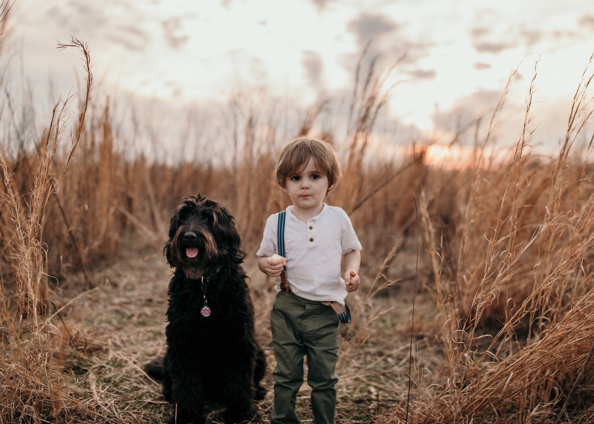 Young Boy Standing with Dog