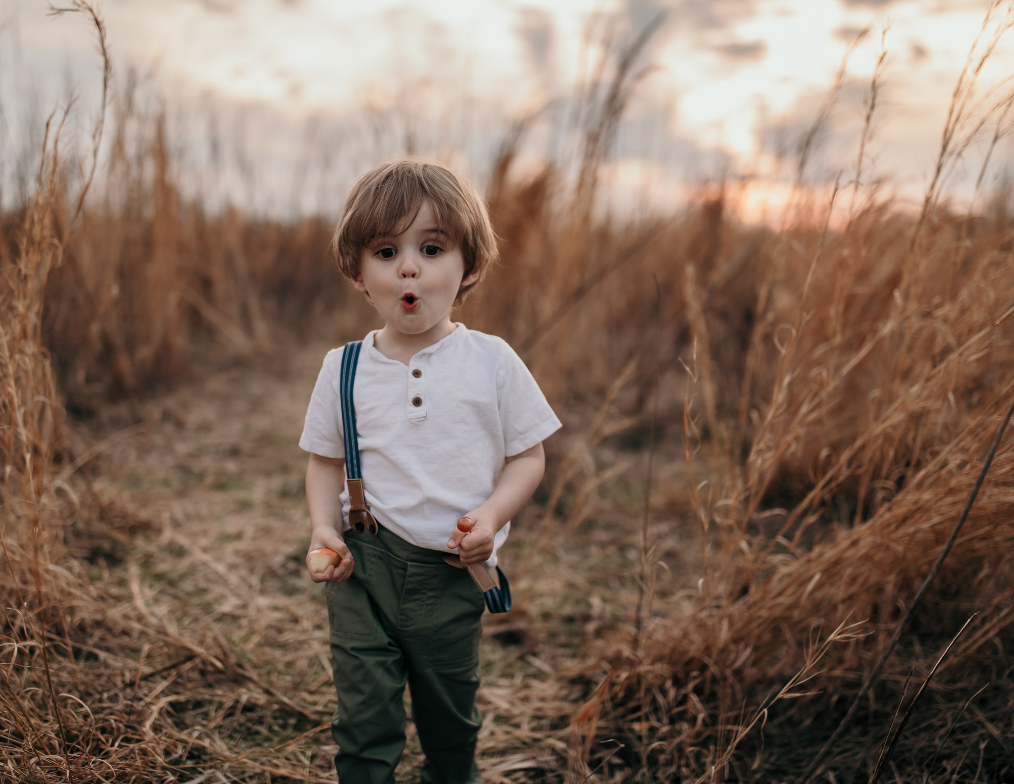 Young Boy Walking in Field