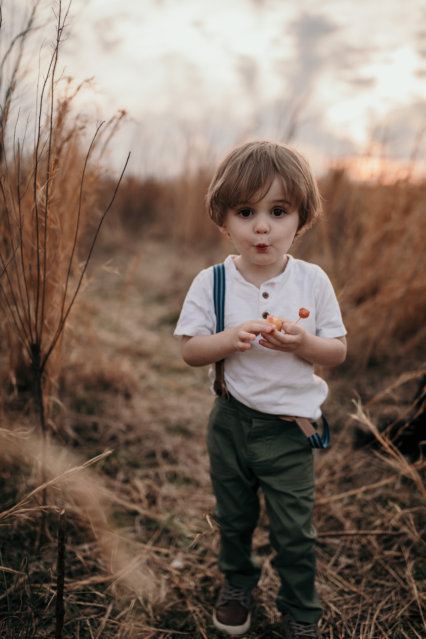 Toddler Standing in Field