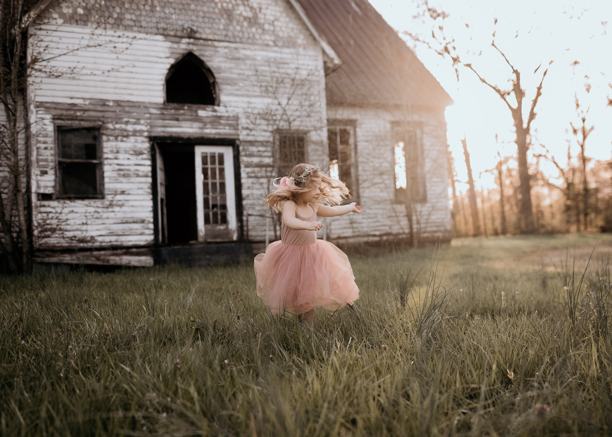 Young Girl Twirling in Field