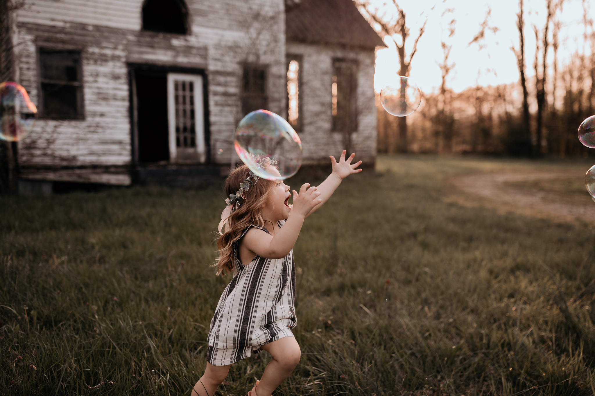 Young Girl Chasing Bubbles