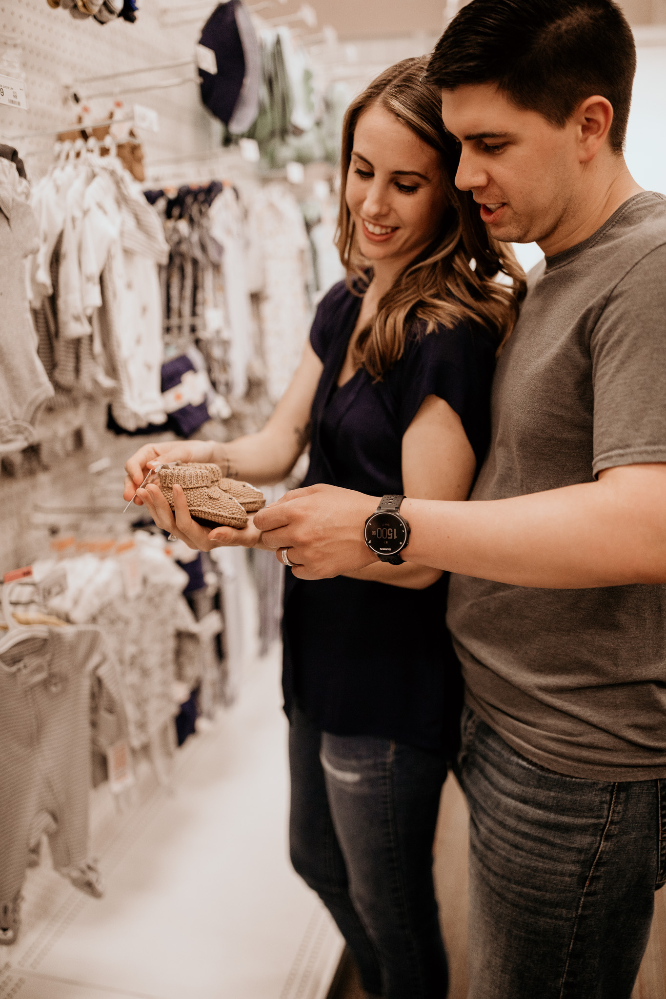 Pregnant Couple Shopping for Little One
