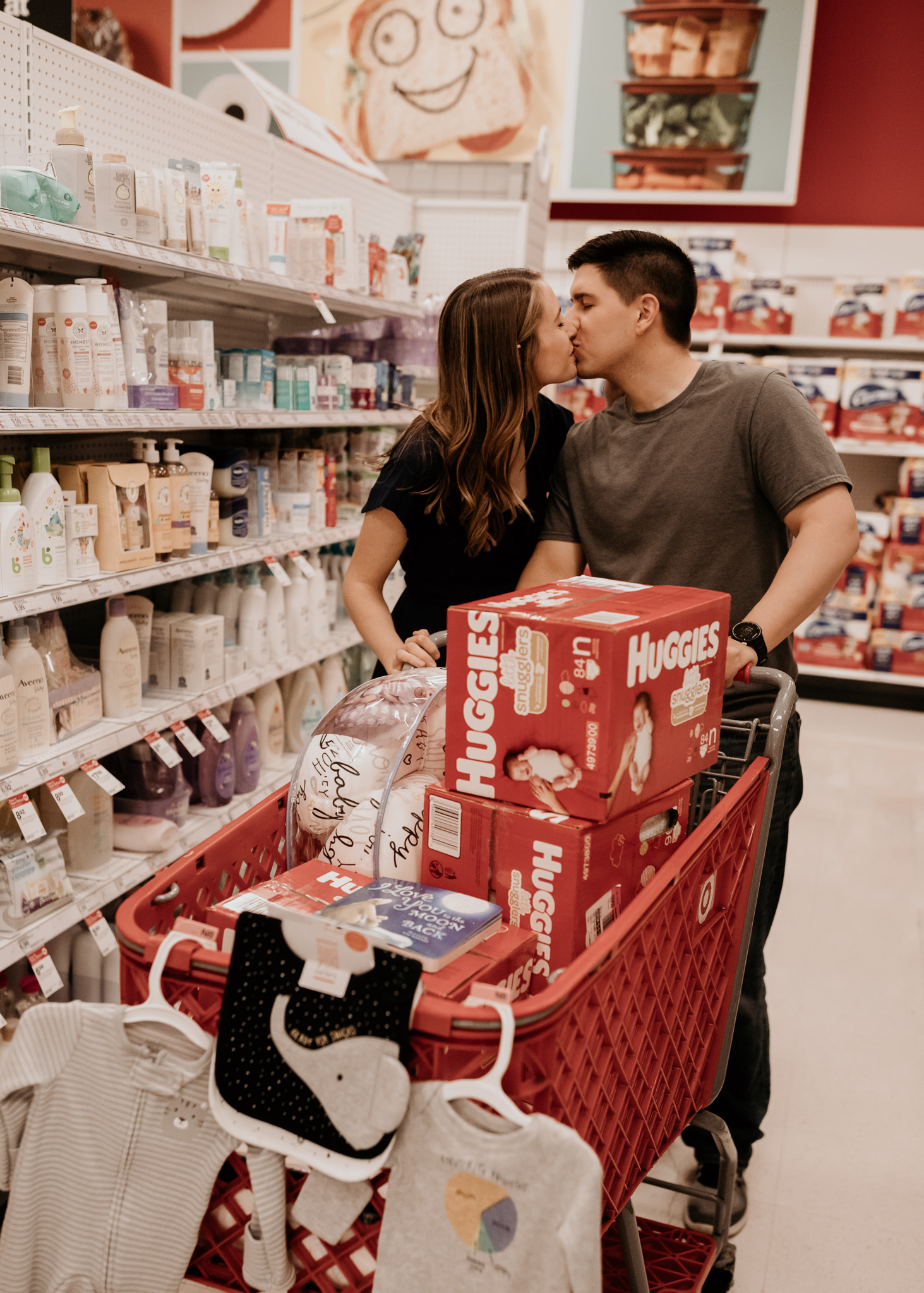 Couple Sharing a Kiss as They Shop