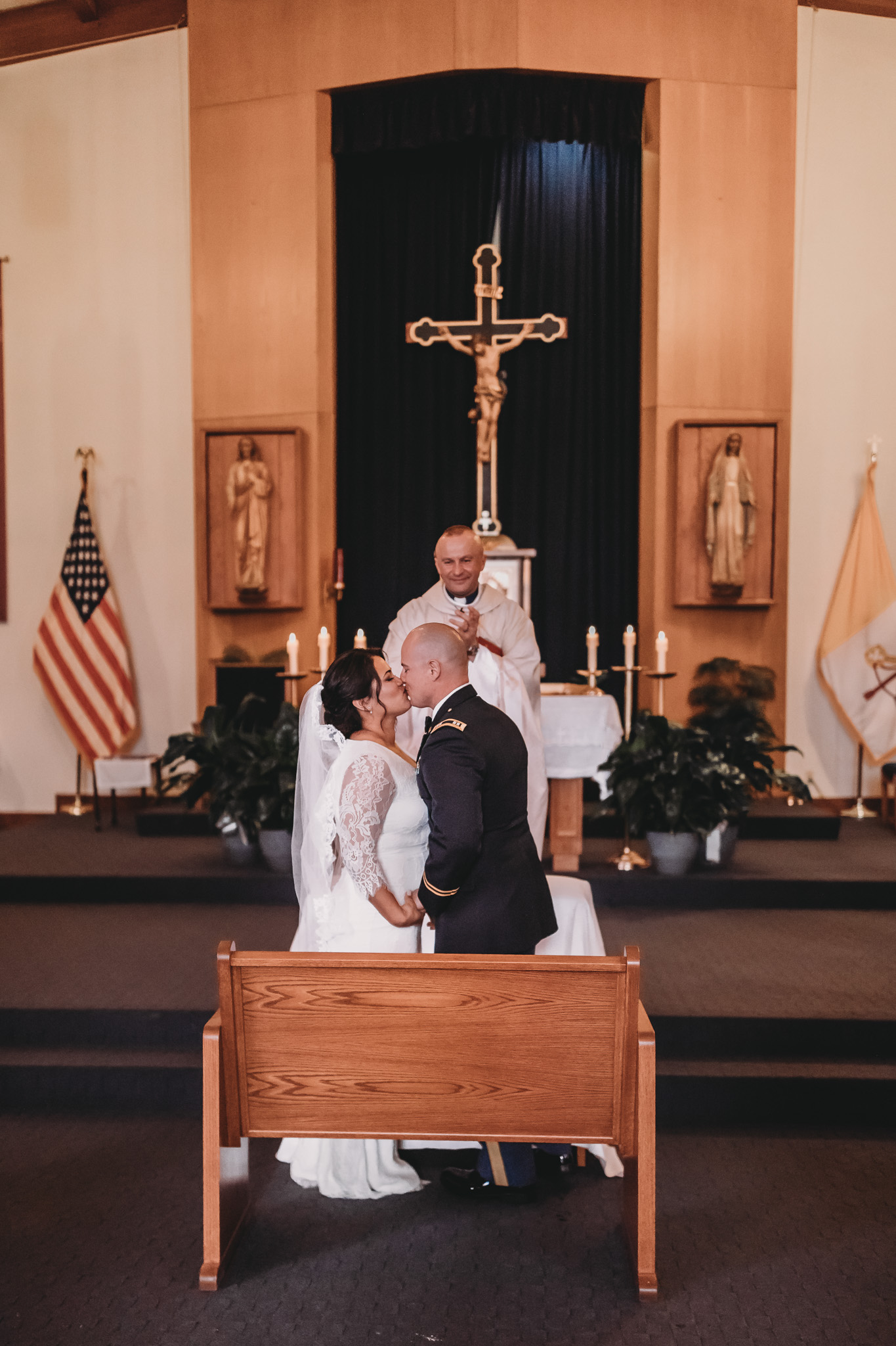 Bride and Groom Kissing in Church