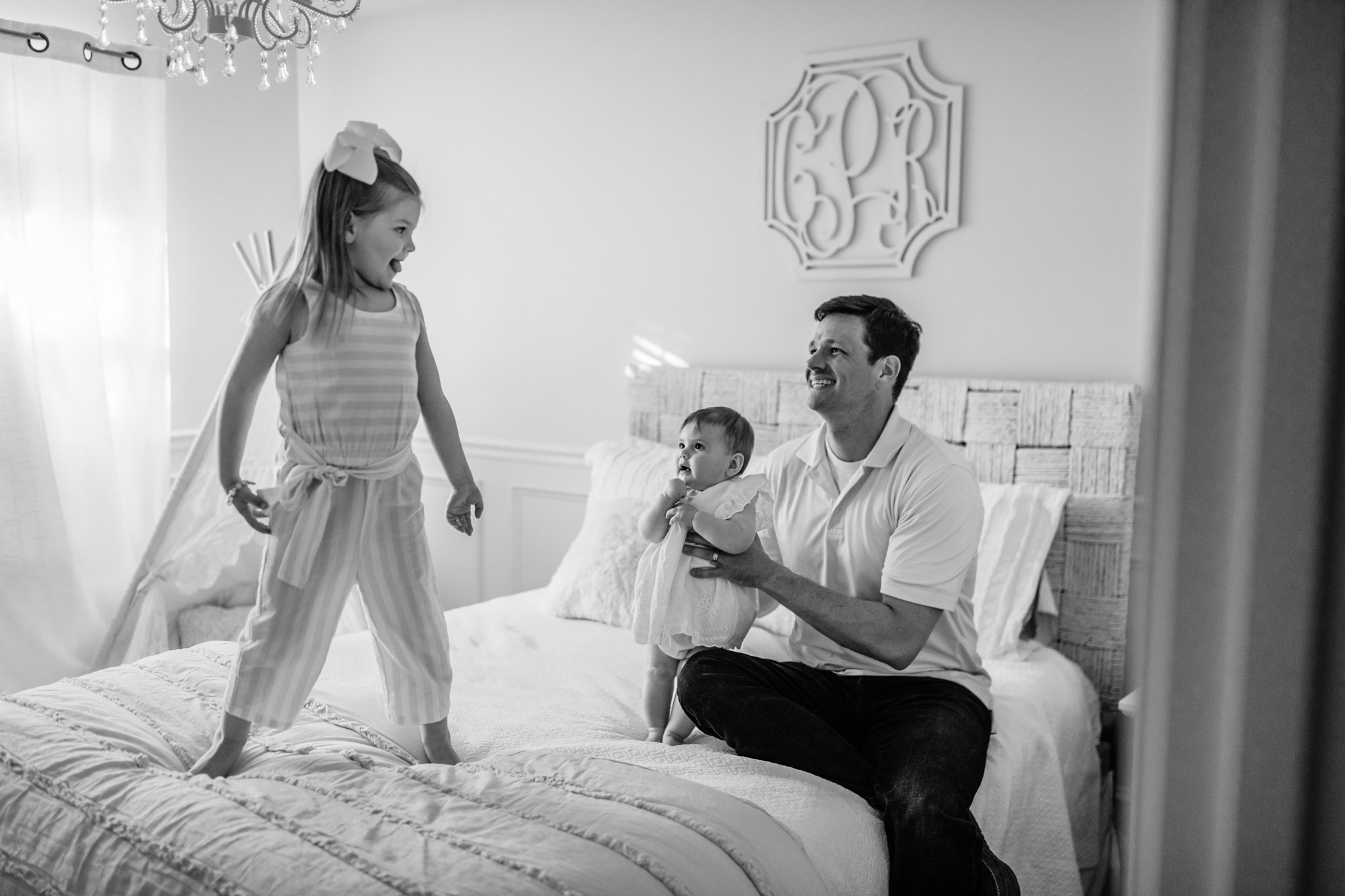Black and White Photo of Father and Daughters