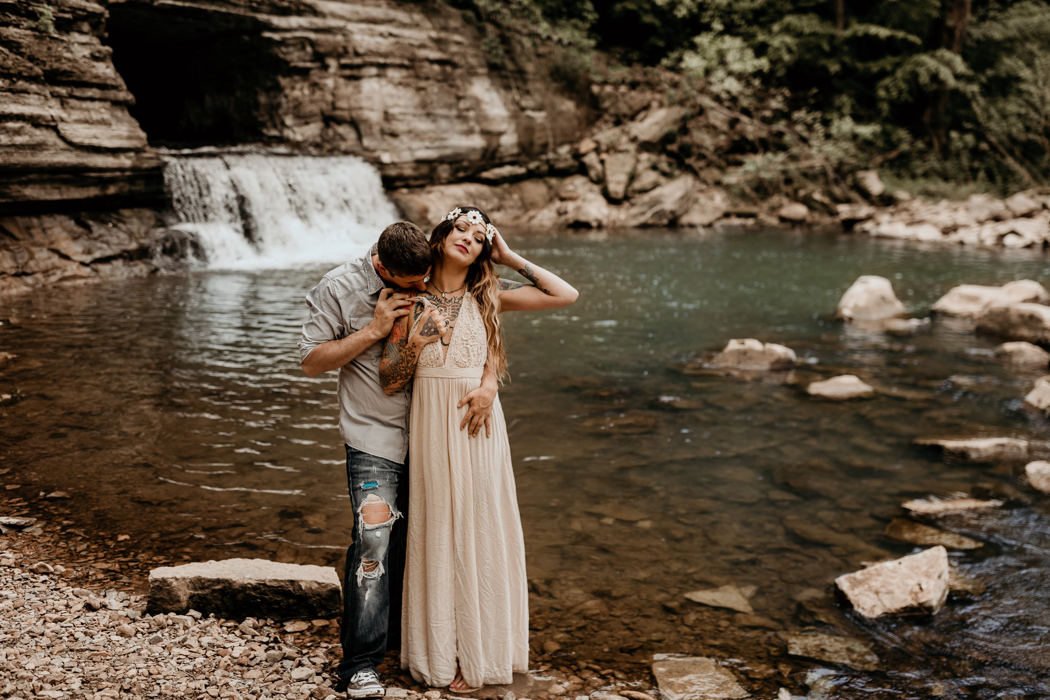 Couple standing by water embracing