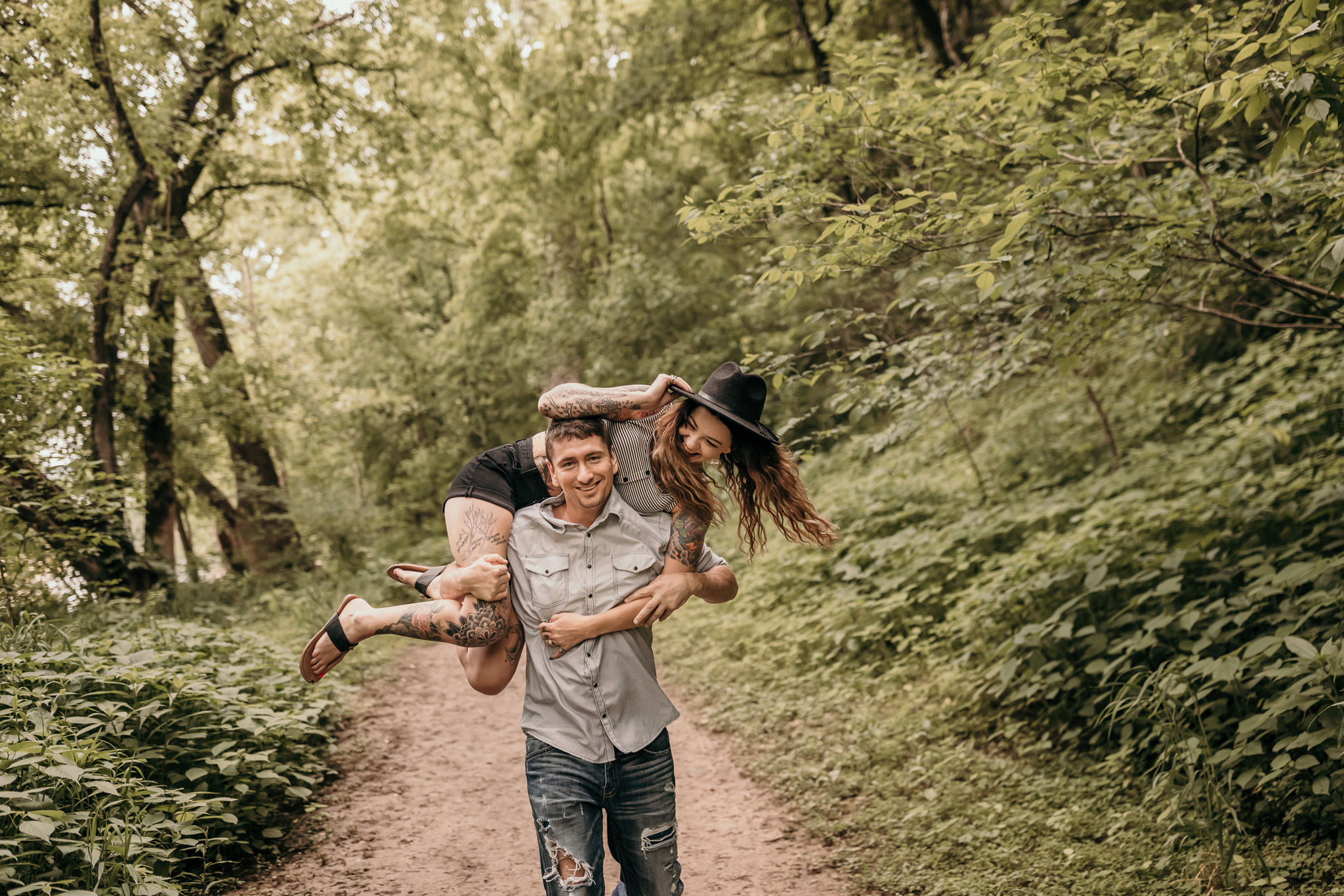 Guy carrying future bride across his shoulders