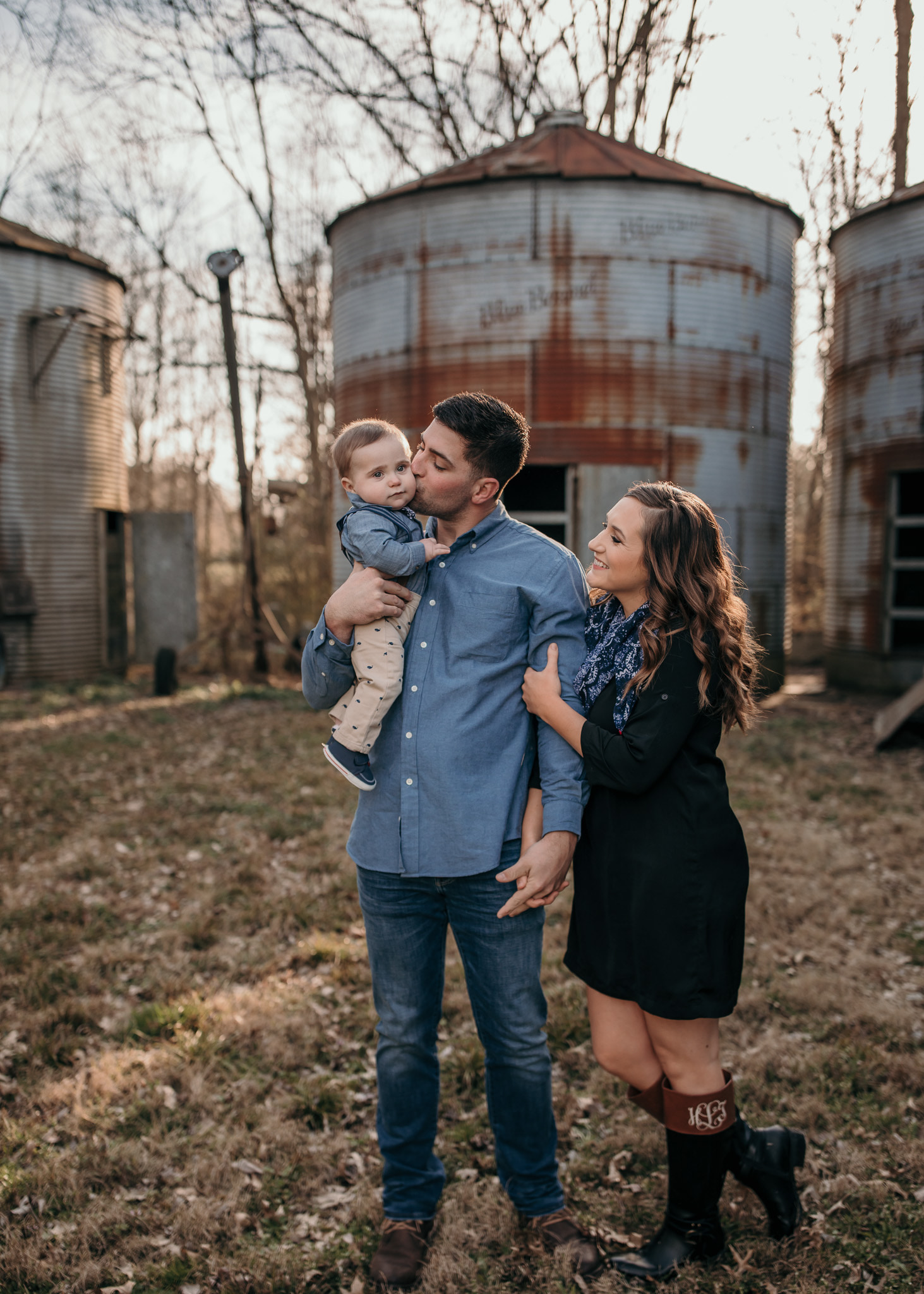 Family photo in front of silos