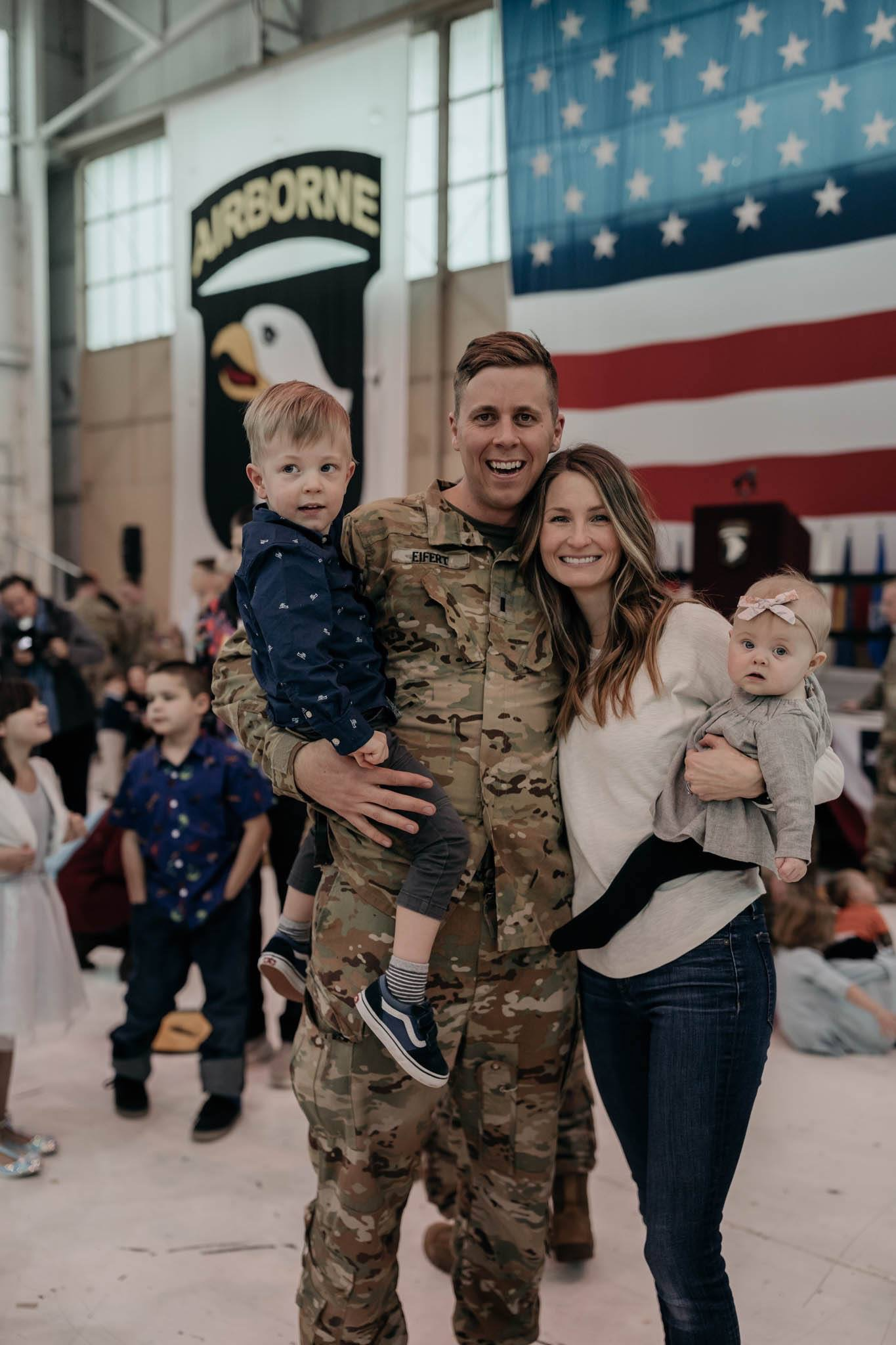 Familing welcoming home their soldier from deployment
