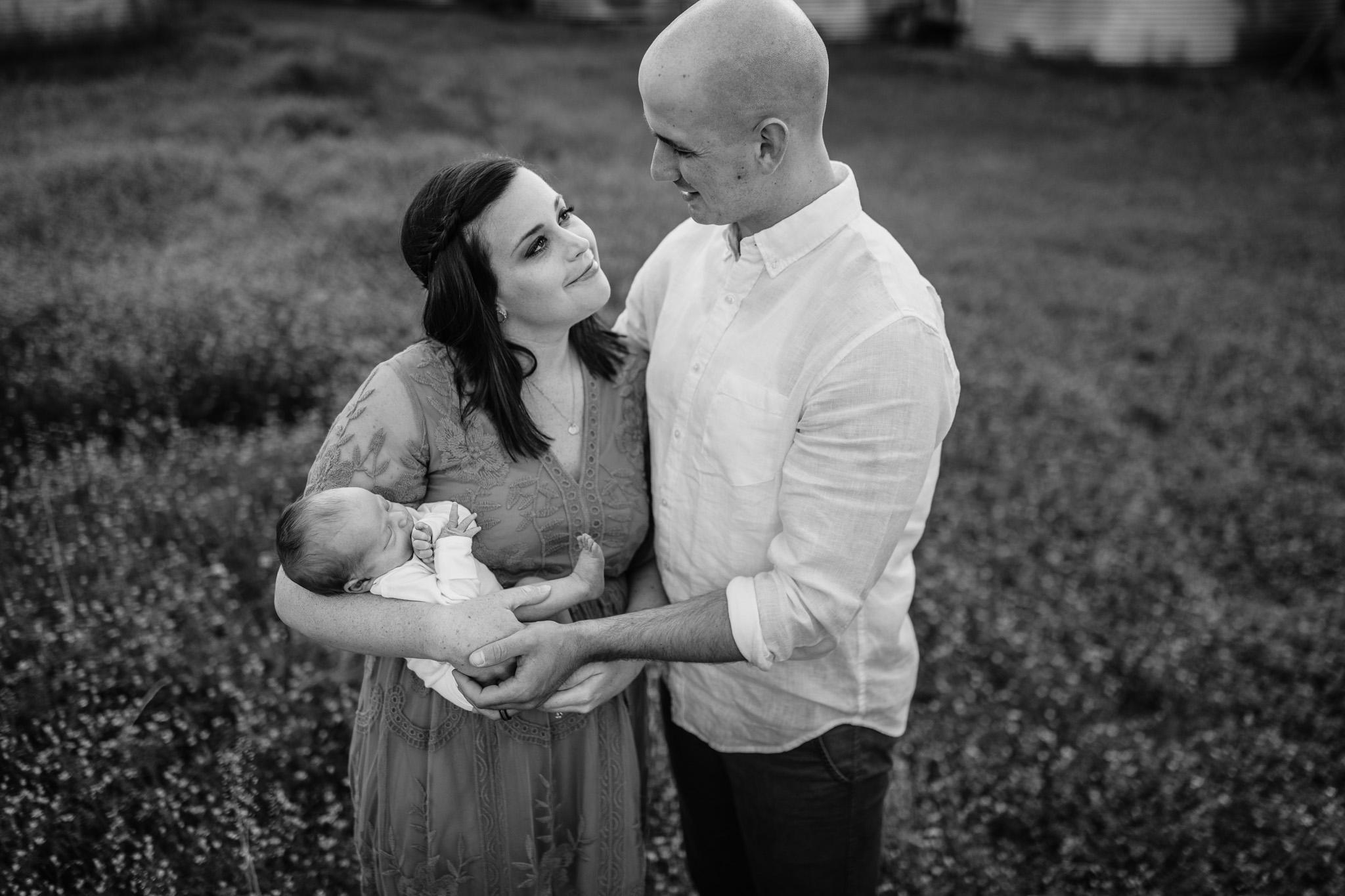 black and white photo of newborn photo outside