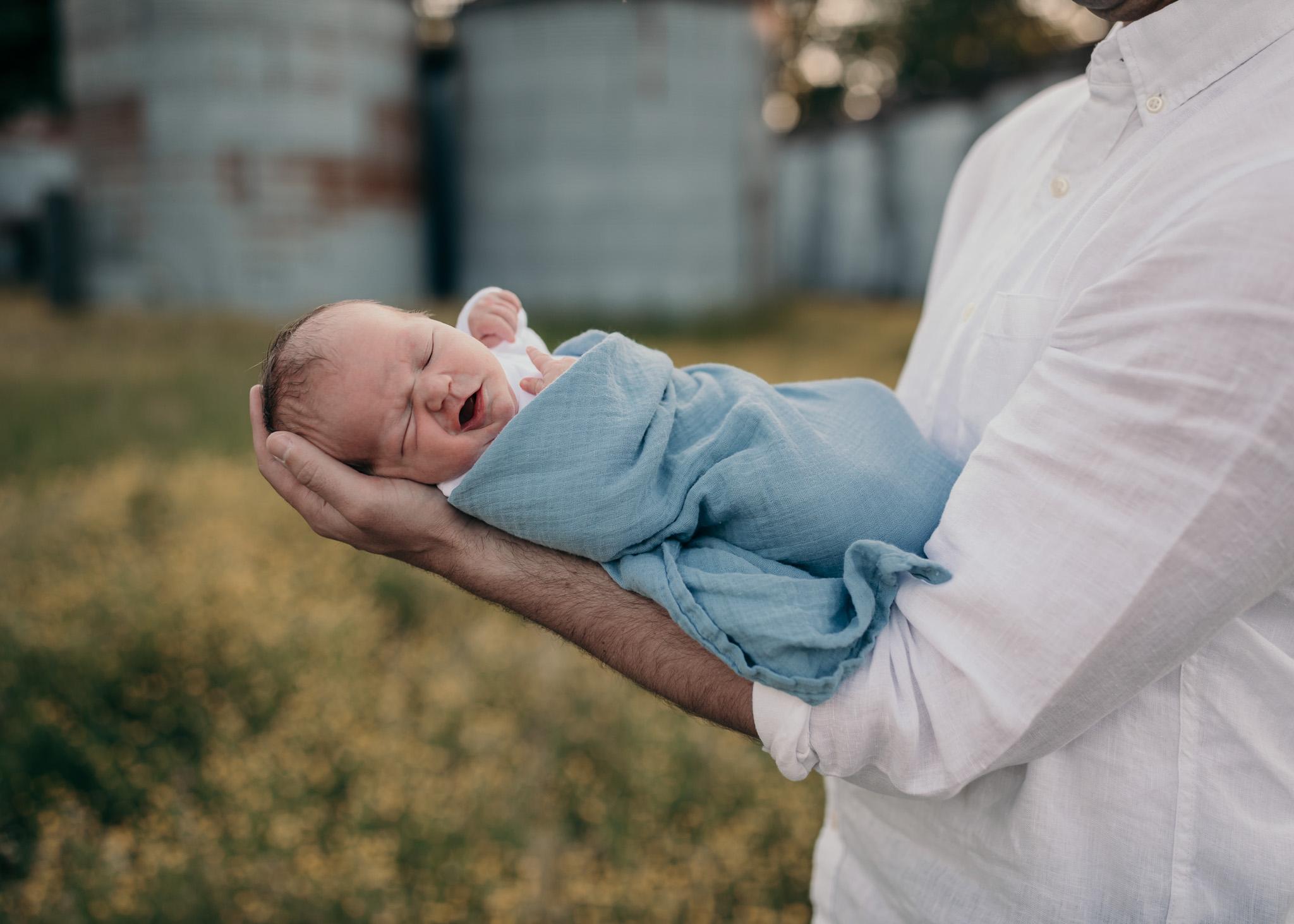 outdoor newborn baby yawn