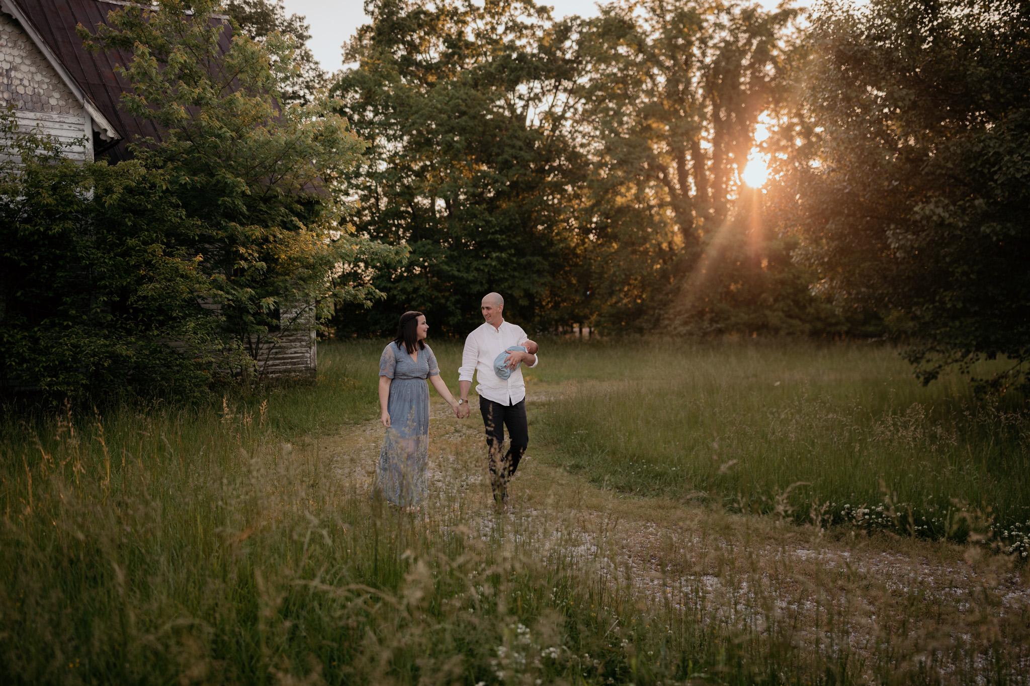 couple walking with newborn