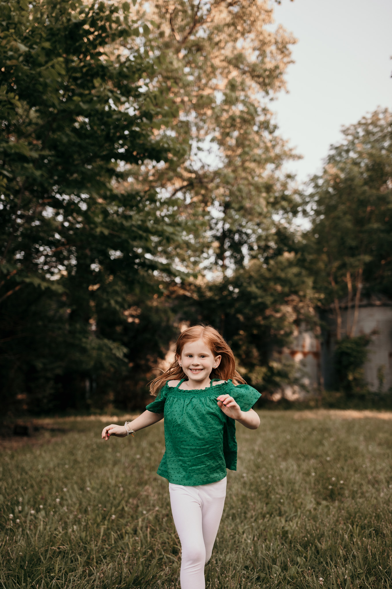 little girl with red hair running