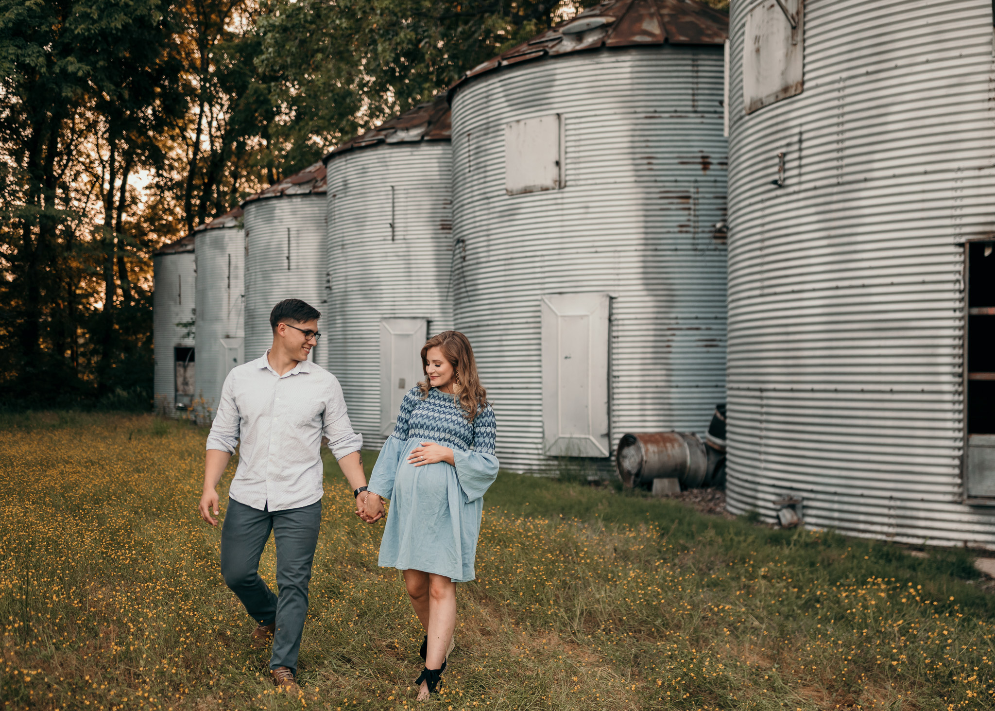 couple walking holding hands maternity pose