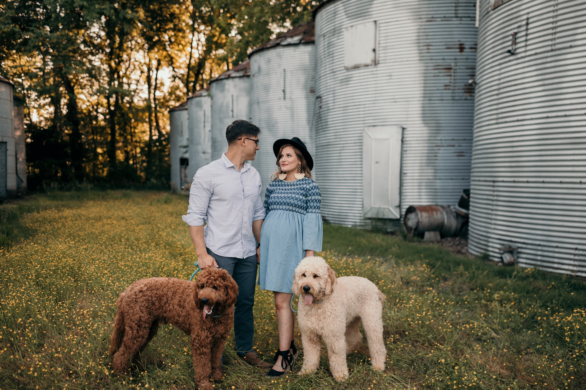 couple with two goldendoodle dogs