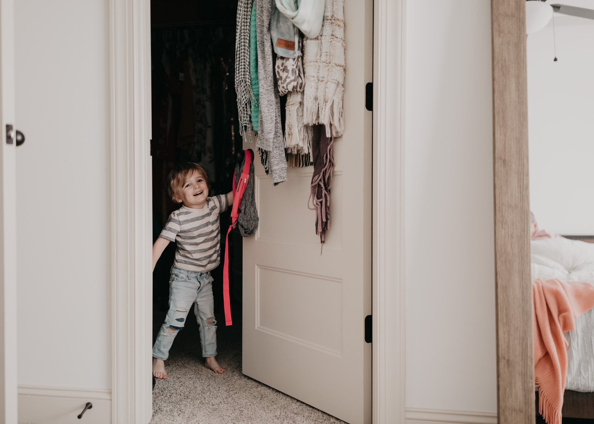 little boy playing in parents room