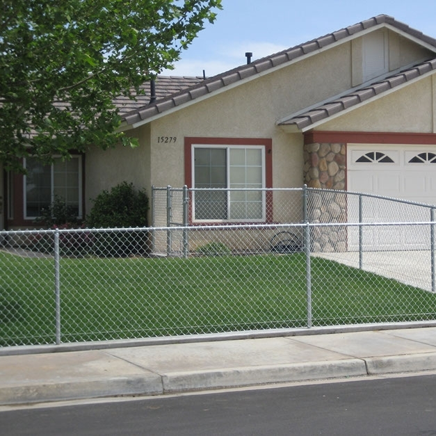 One of ours! A very low chain link fence keeps the dog and kids safely inside the from yard.