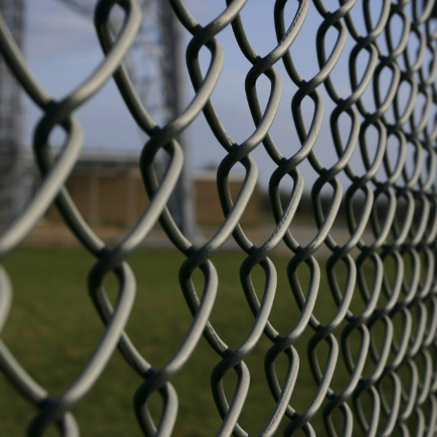 Schools often used chain link fencing, leaving fencing with noise barriers up to the neighboring houses.